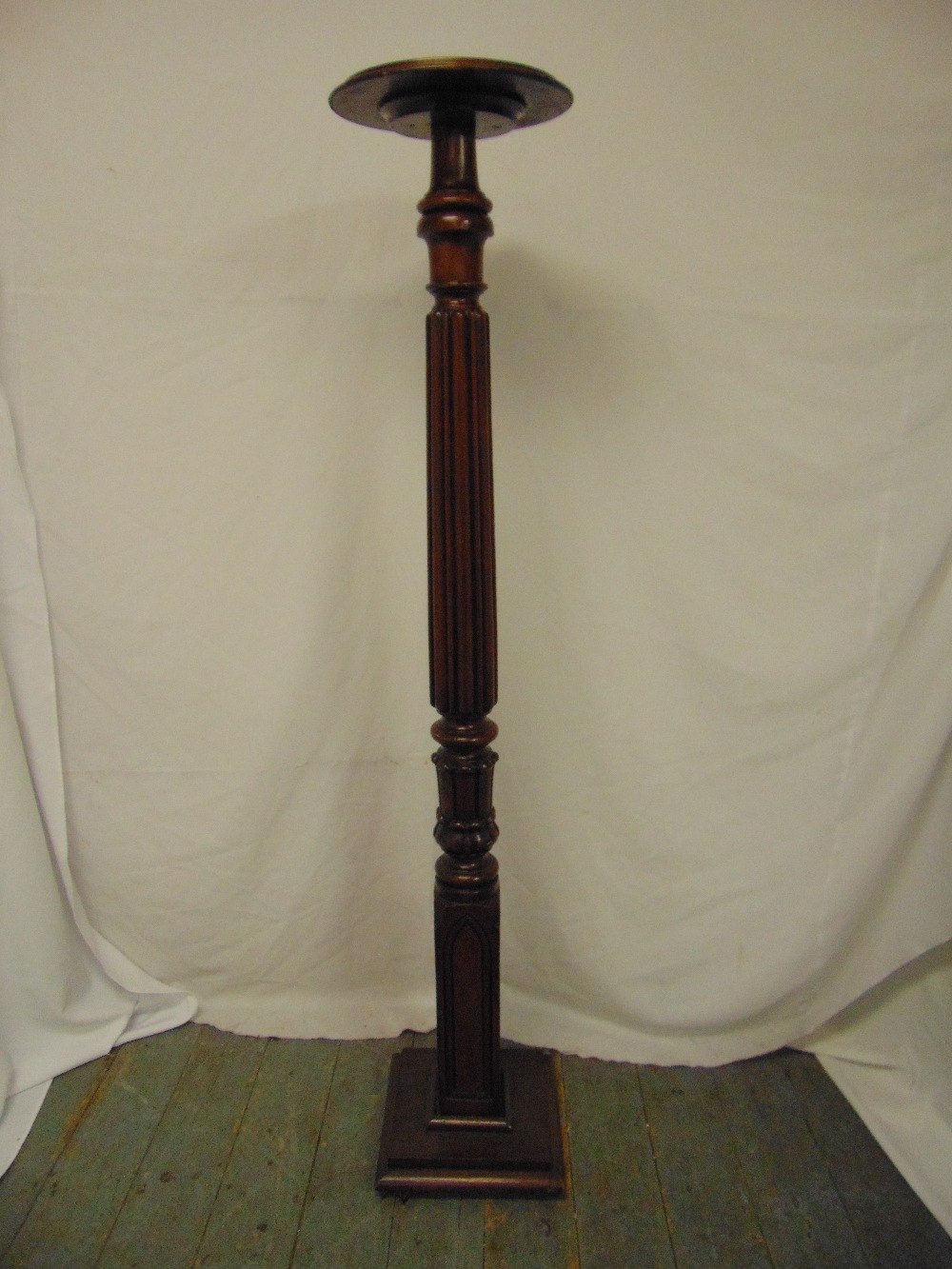 Lot 25 - A Victorian mahogany torchere the carved cylindrical column on raised square base