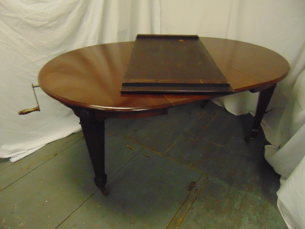 Lot 16 - A Victorian shaped oval mahogany dining table with two drop in leaves and Joseph screw mechanism, by