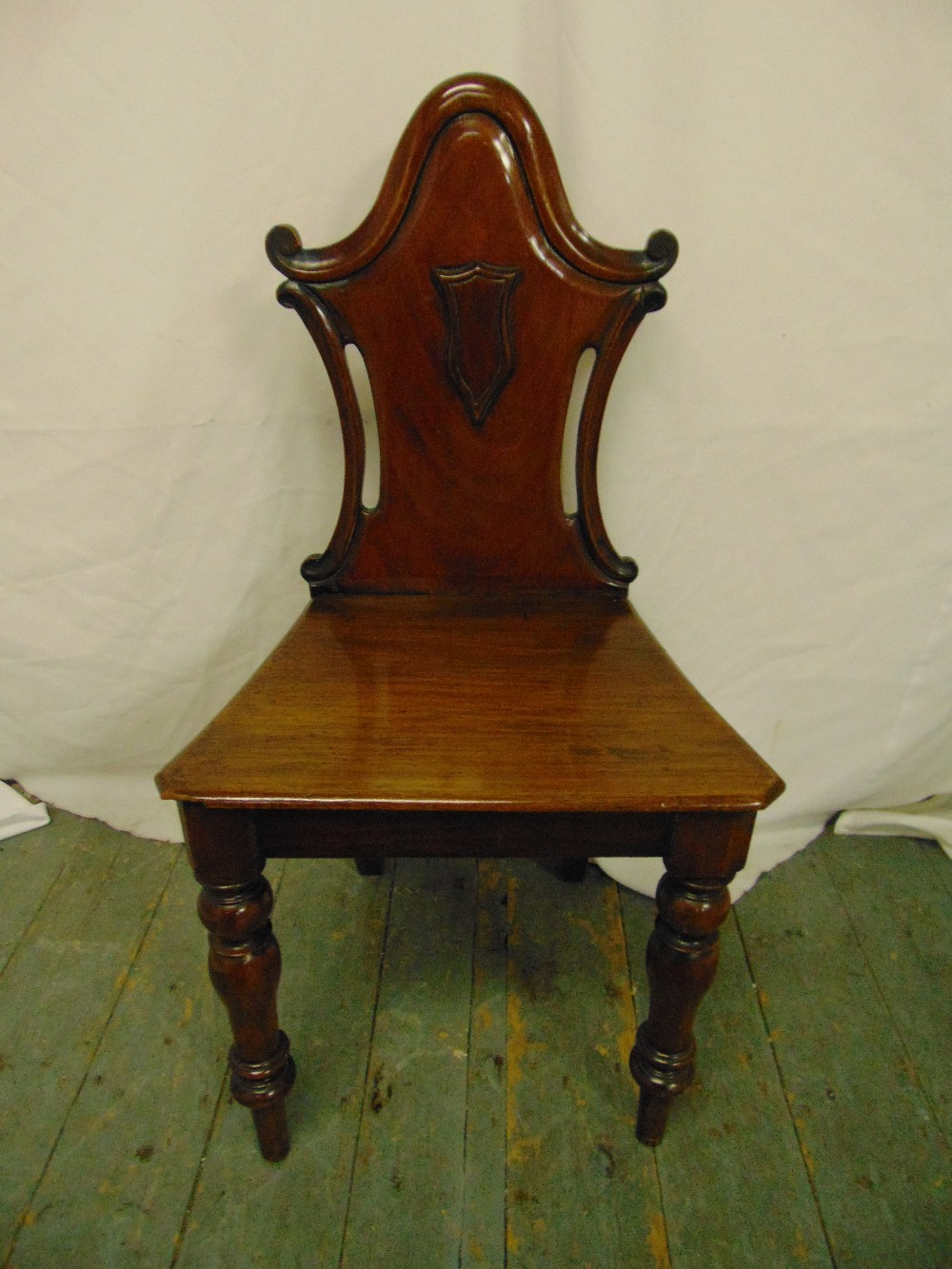 Lot 36 - A Victorian mahogany hall chair, pierced back on turned baluster legs