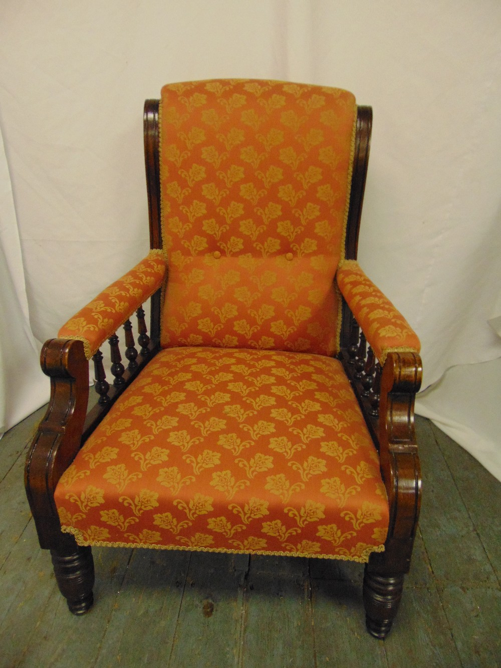 Lot 28 - A Victorian mahogany upholstered armchair with galleried arms on turned cylindrical legs