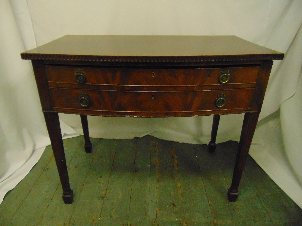 Lot 4 - A rectangular mahogany two drawer table with brass handles on tapering rectangular legs