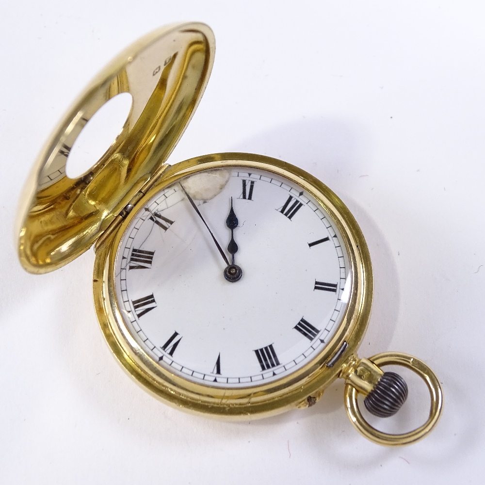 Lot 468 - A Swiss 18ct gold half hunter side-wind pocket watch, with blue enamelled chapter dial, movement