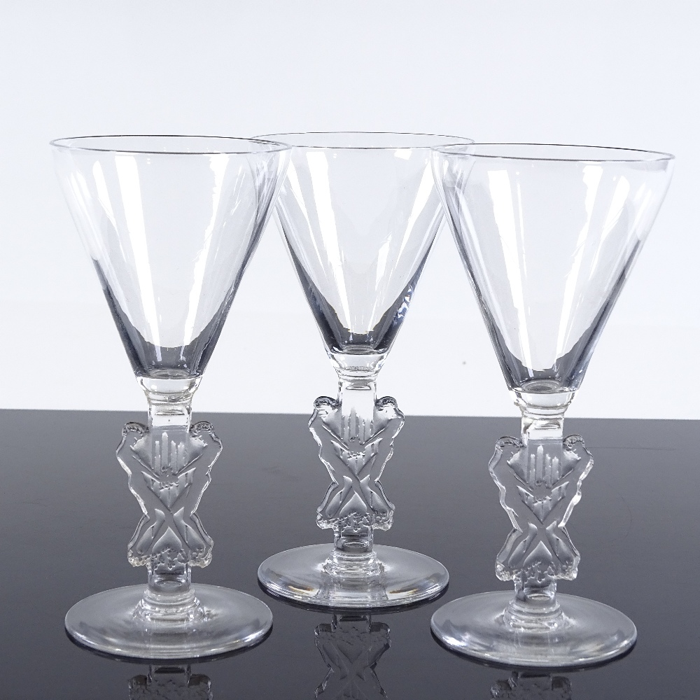 Lot 23 - Rene Lalique set of 3 glasses with funnel-shaped bowls and moulded Classical figure design stems,