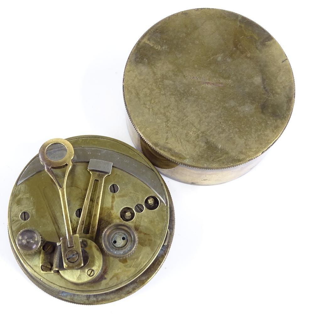 Lot 58 - A Stanley brass-cased surveyor's level, dated 1911, diameter 8cm