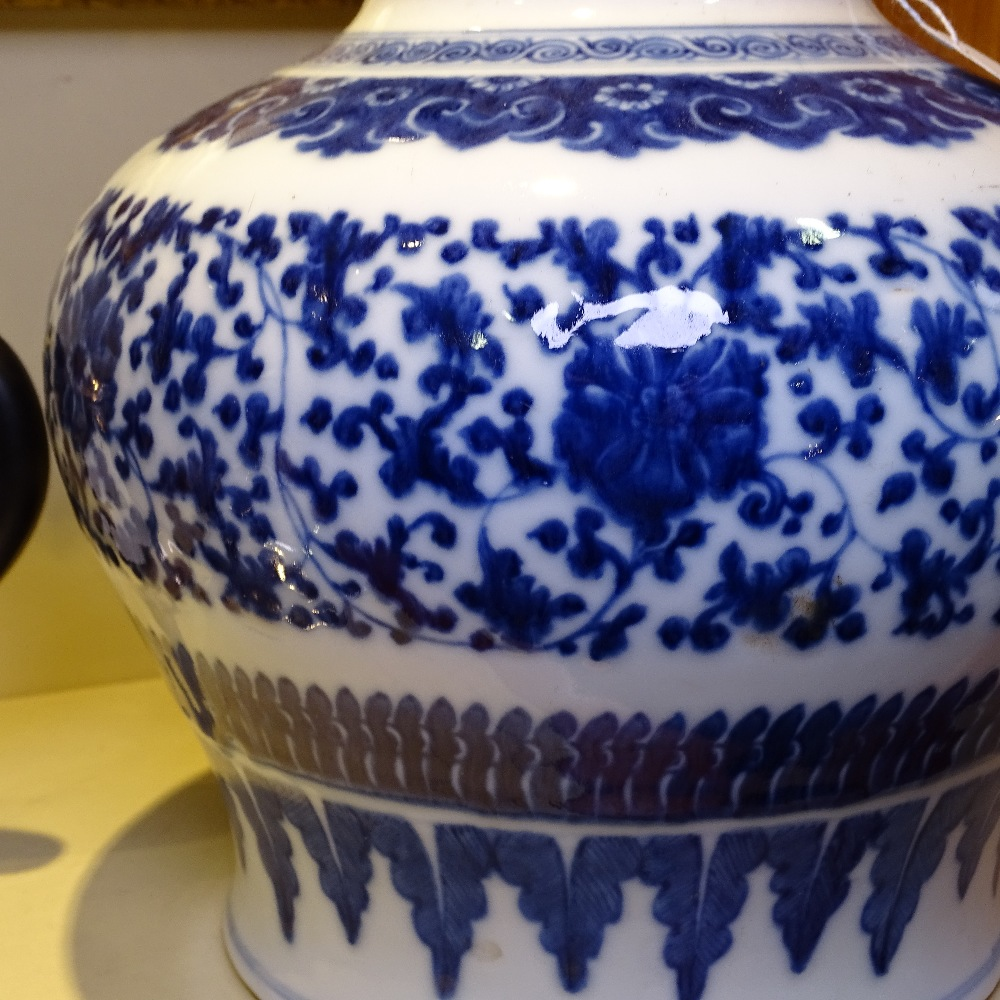 Lot 6 - A Chinese blue and white porcelain baluster vase, 18th/19th century, hand painted detailed floral
