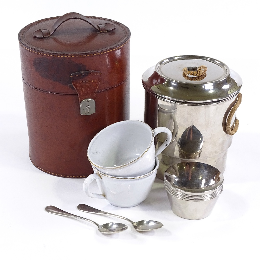Lot 5 - WMF travelling Tea for Two picnic set in original cylindrical leather case, mid-20th century,