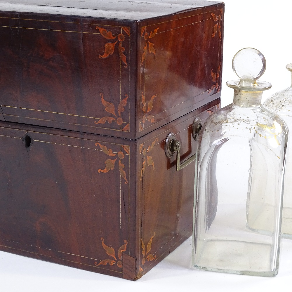 Lot 4 - A 19th century mahogany and marquetry inlaid decanter box, containing 2 original gilded glass square