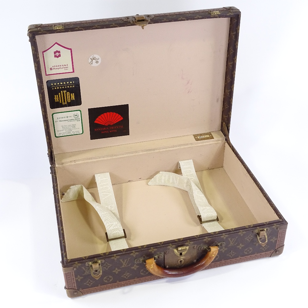 Lot 3 - A Vintage Louis Vuitton monogram suitcase, with brass fittings and original leather handle, 50cm x