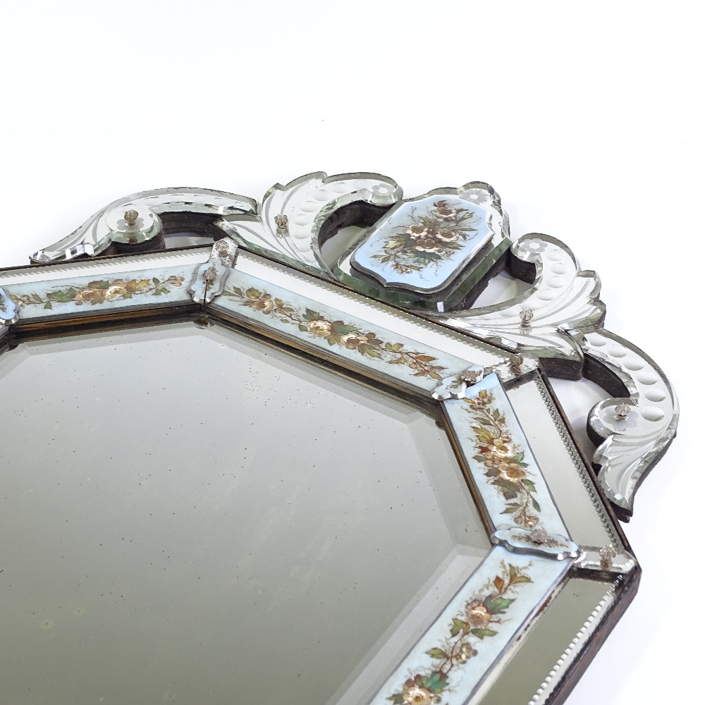 Lot 40 - An Italian shield-shaped wall mirror, late 19th century, with applied hand painted blue and opaque