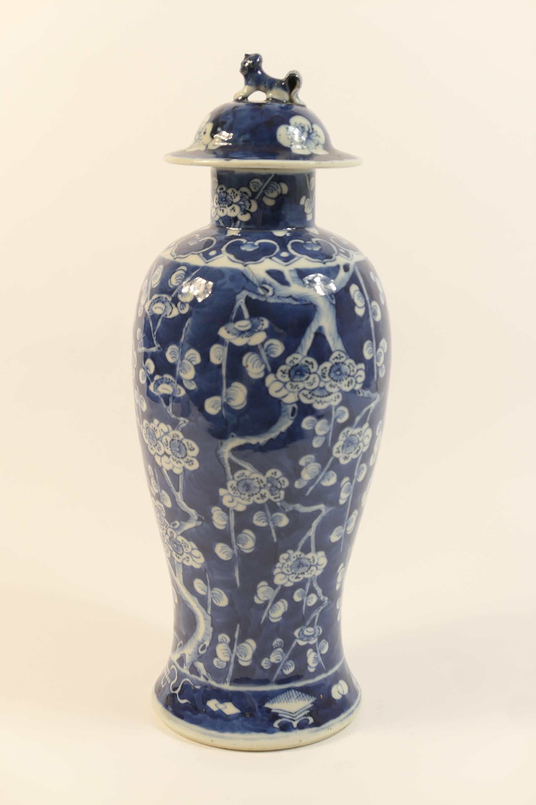 Lot 9 - Chinese blue and white prunus pattern covered vase, late 19th Century, slender ovoid form with domed
