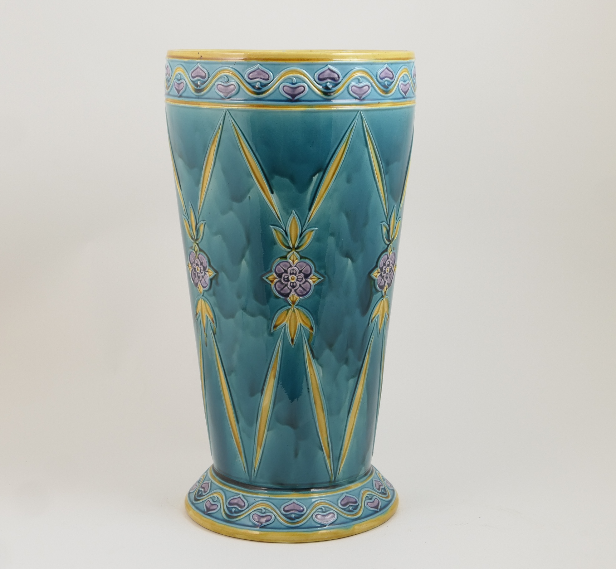 Lot 48 - Minton Secessionist majolica stick stand, date code for 1914, tapered cylinder form decorated with