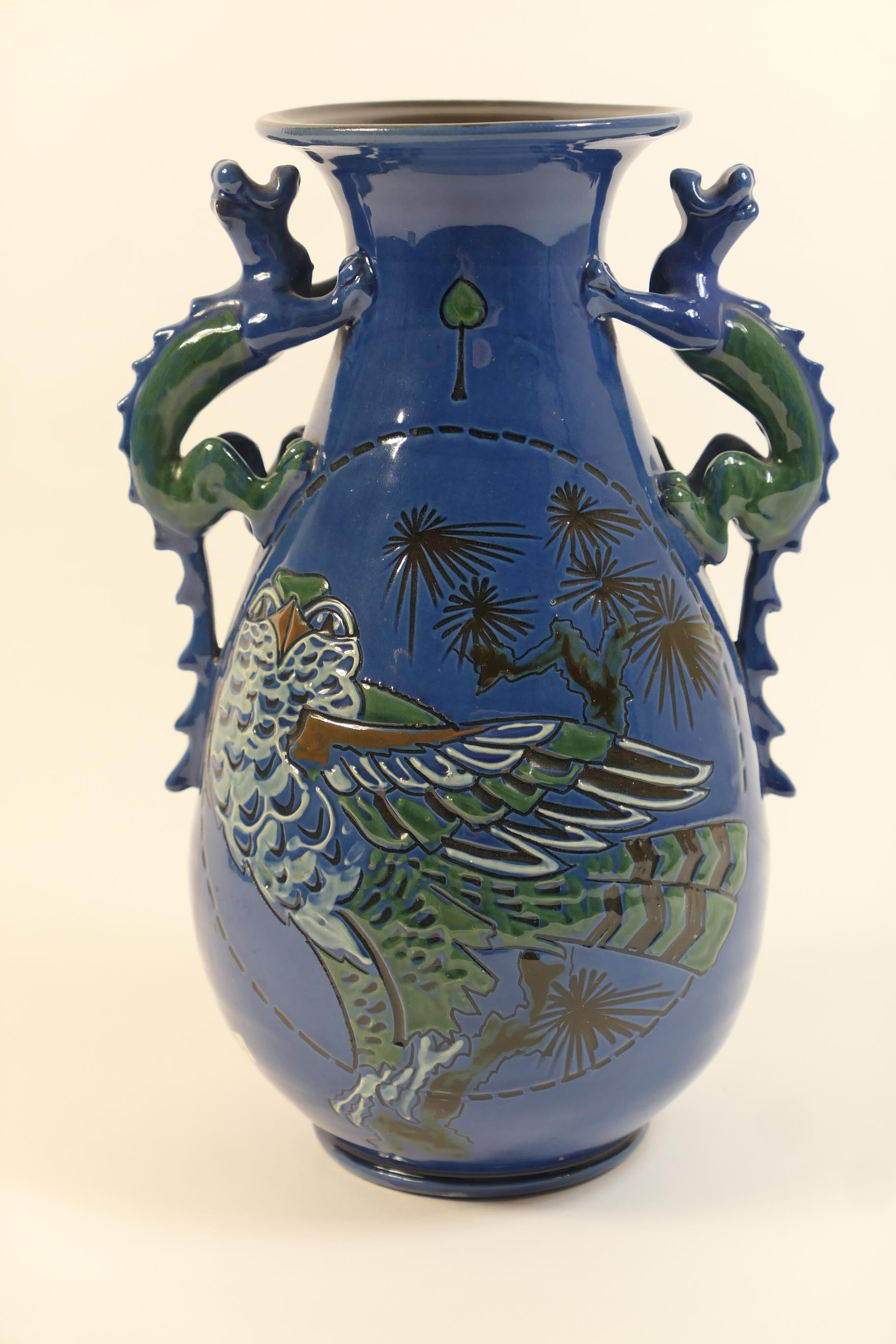 Lot 4 - Brannam Barum vase, attributed to James Dewdney, baluster form with dragon handles at the neck,