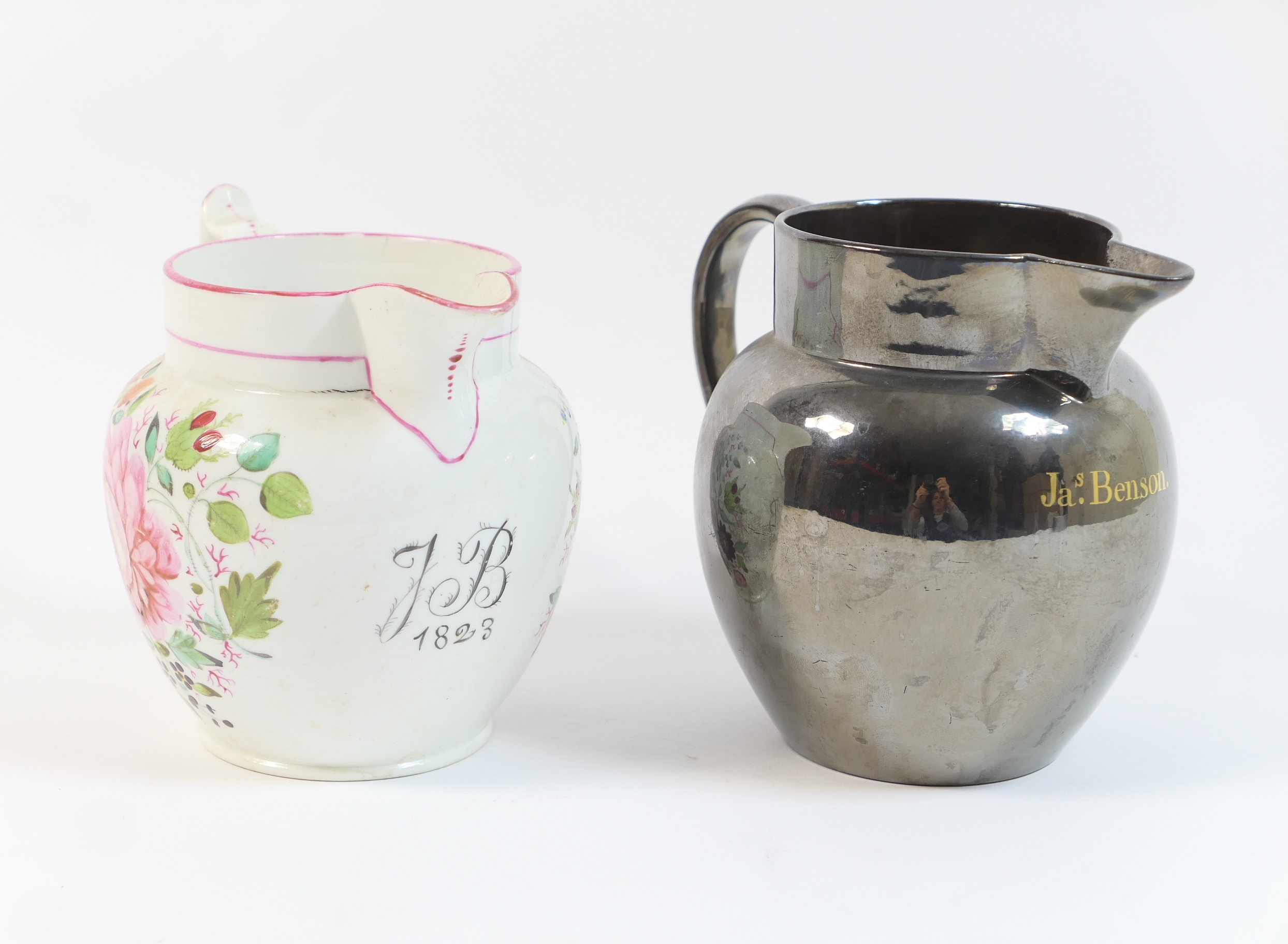 Lot 38 - Staffordshire dated milk jug, circa 1823, decorated with floral sprays in bold colours, against a
