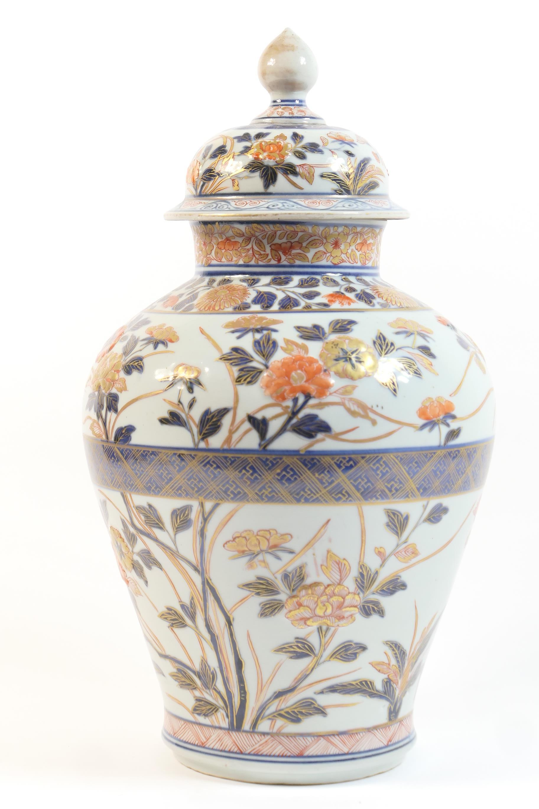 Lot 25 - Japanese Arita porcelain jar and cover, Meiji (1868-1912), decorated in typical Imari palette with
