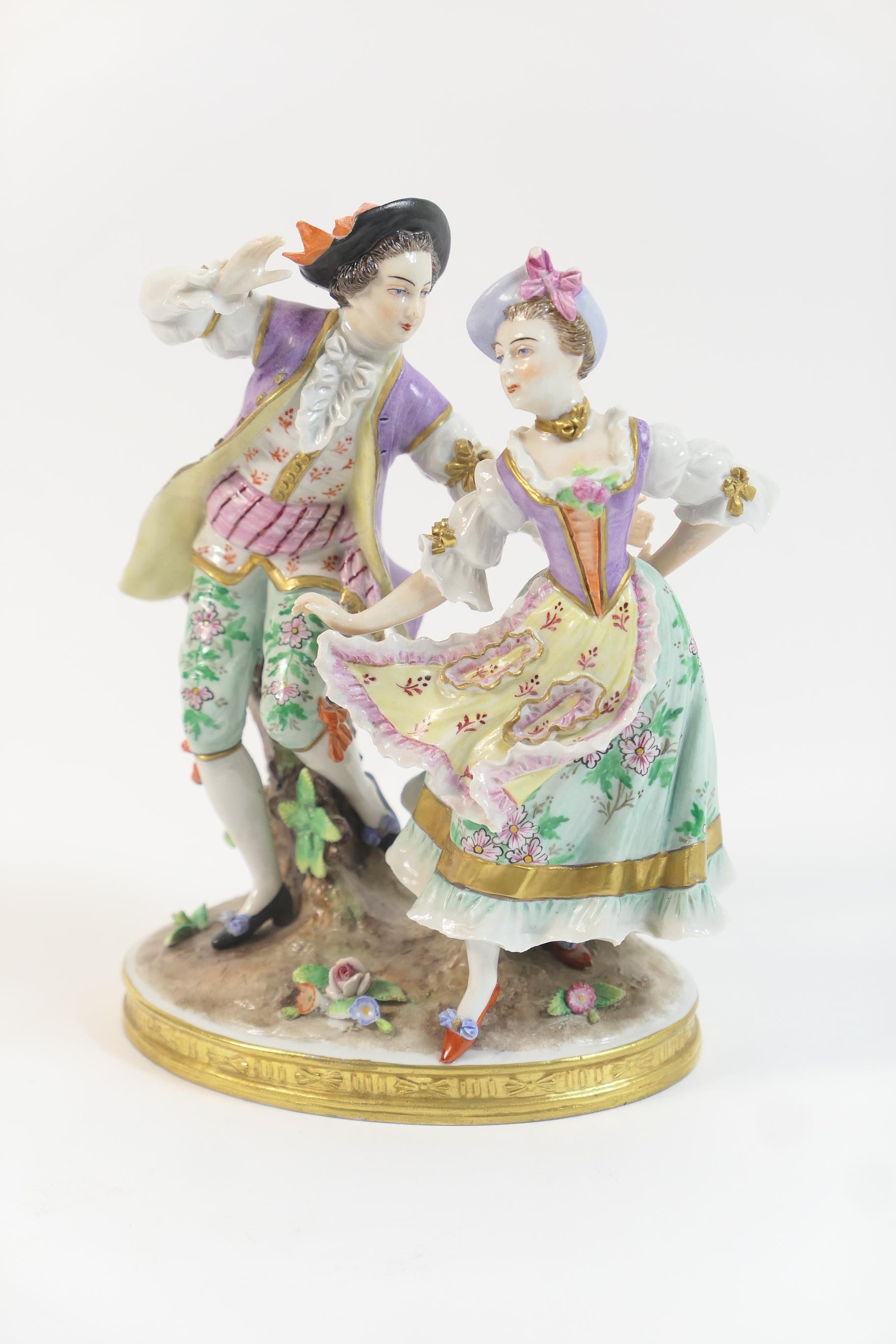 Lot 51 - Sitzendorf porcelain figure group of dancing courtiers, decorated in colours heightened with gilt,