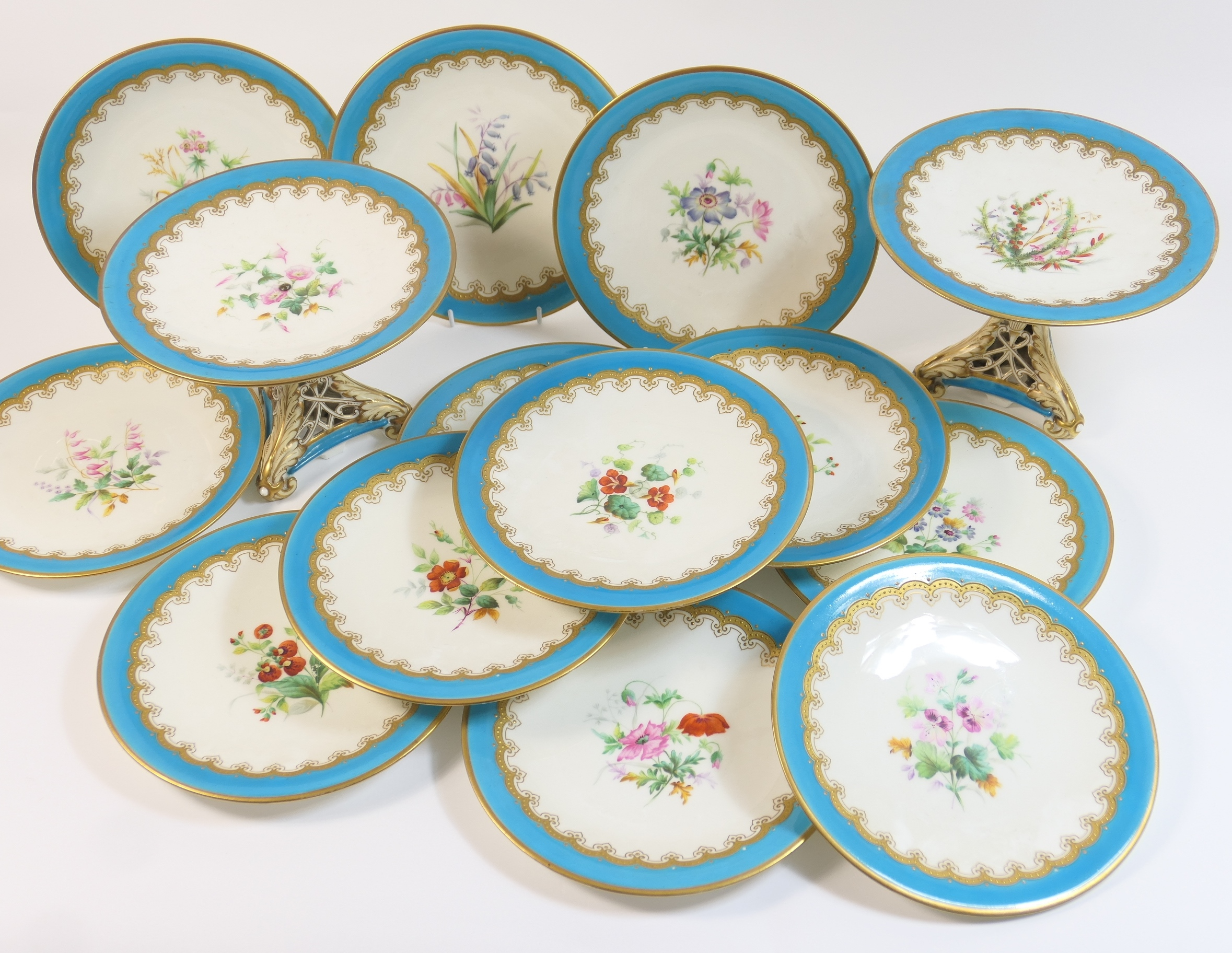 Lot 43 - Victorian china dessert service, circa 1870, comprising two tall comports and twelve dessert plates,