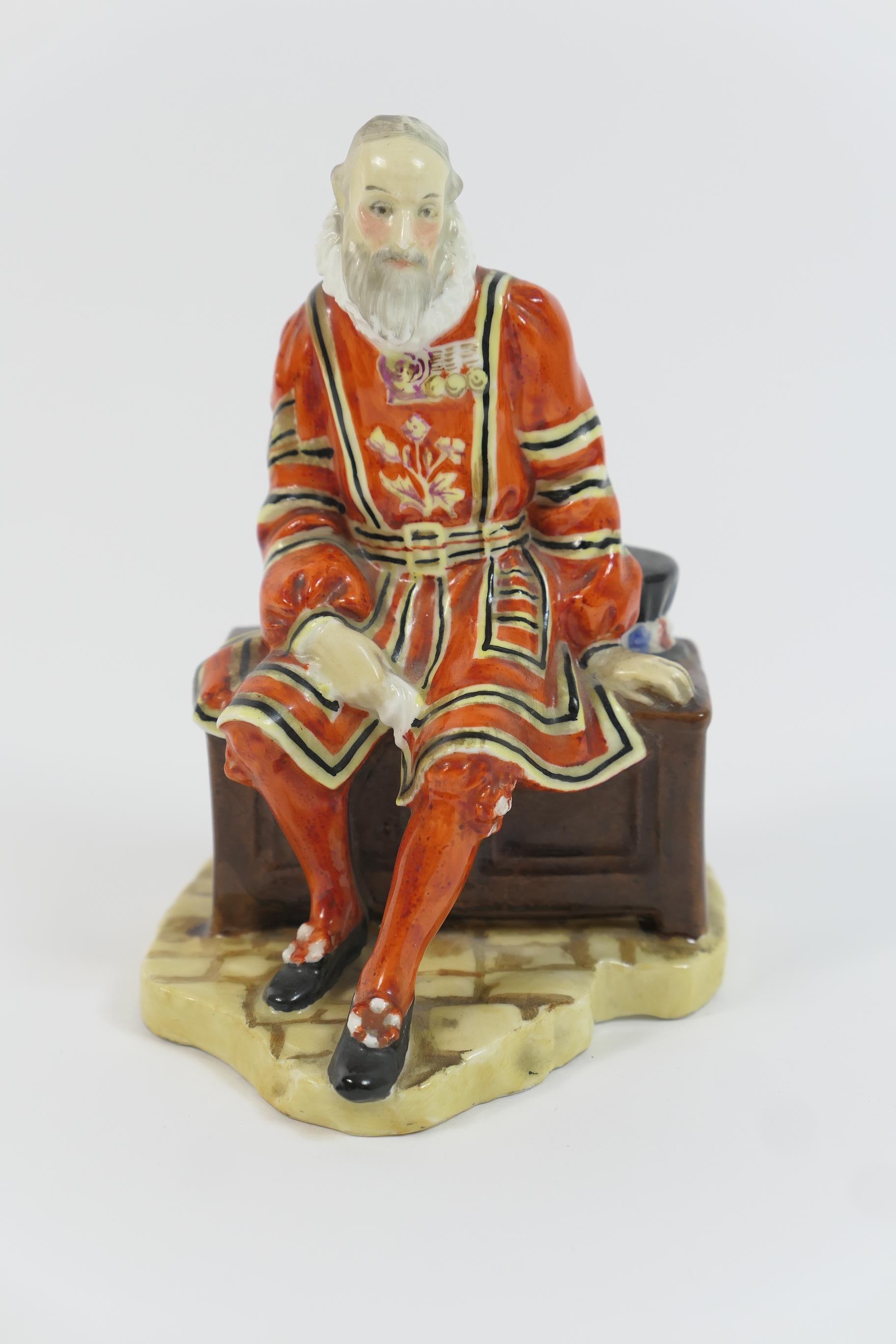 Lot 1 - Royal Doulton china figure 'A Yeoman of the Guard', HN688, designed by L Harradine, issued 1924-
