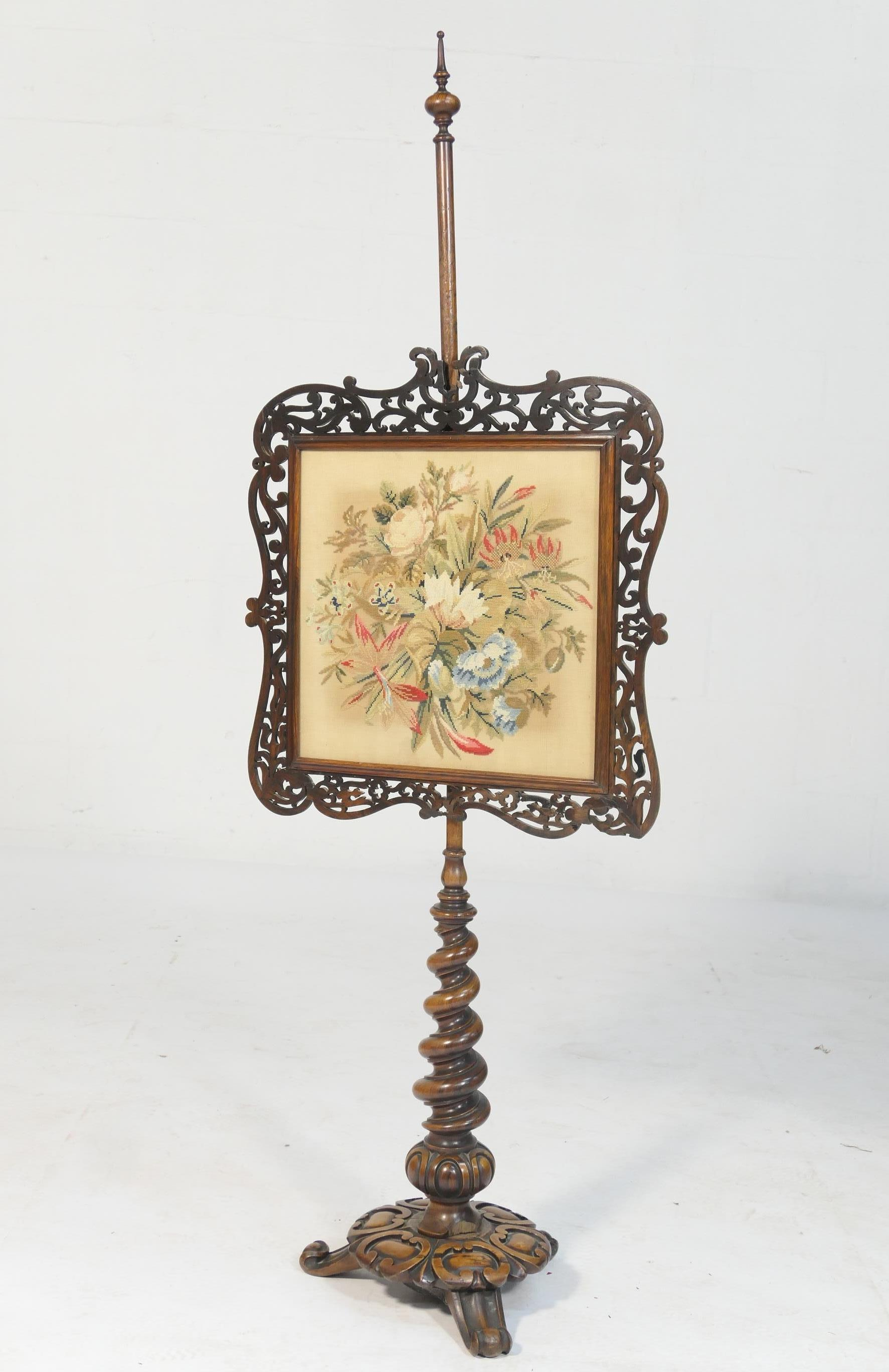 Lot 695 - William IV rosewood pole screen, circa 1835, having a fretwork bordered gross-point needlework