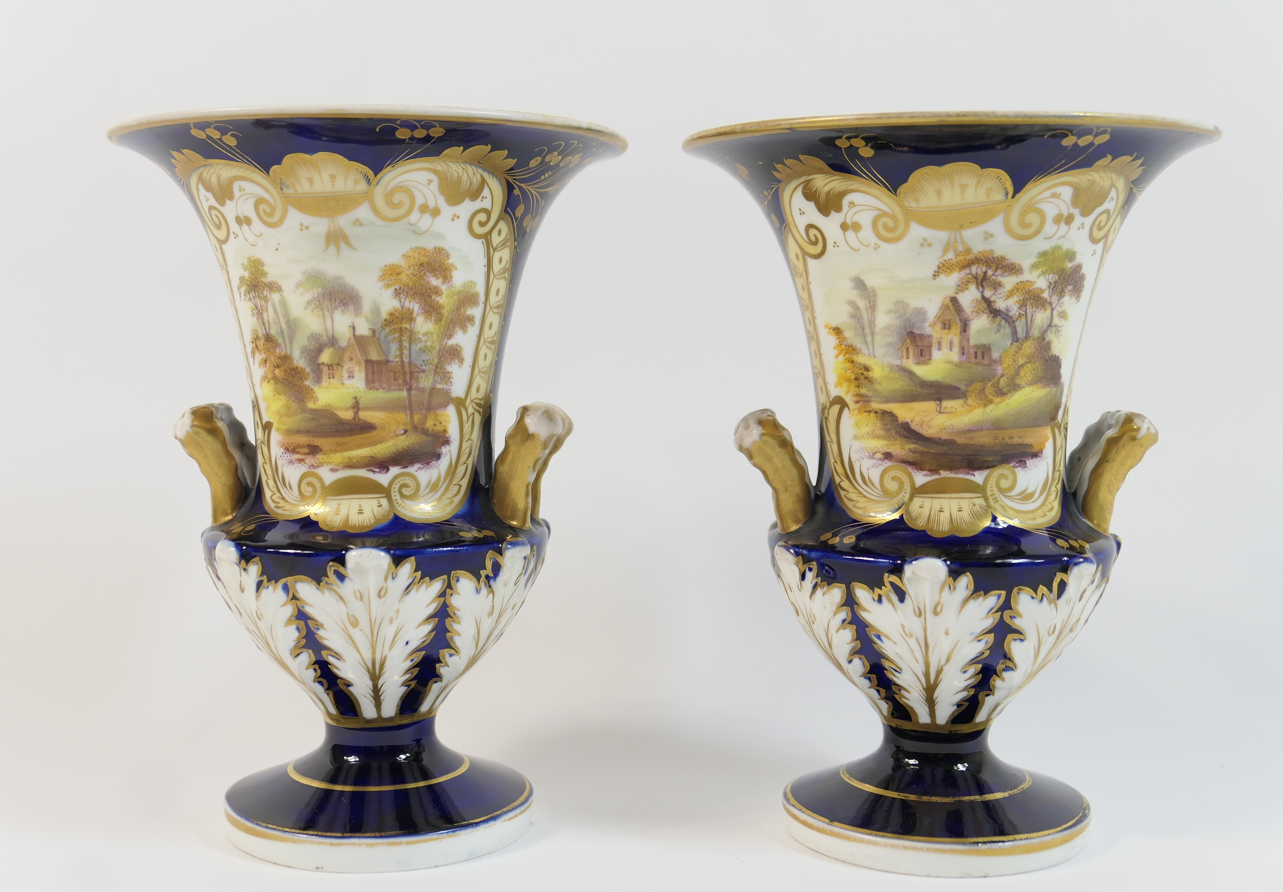 Lot 16 - Pair of Victorian china vases, circa 1845, of slender campagna form, decorated with a landscape