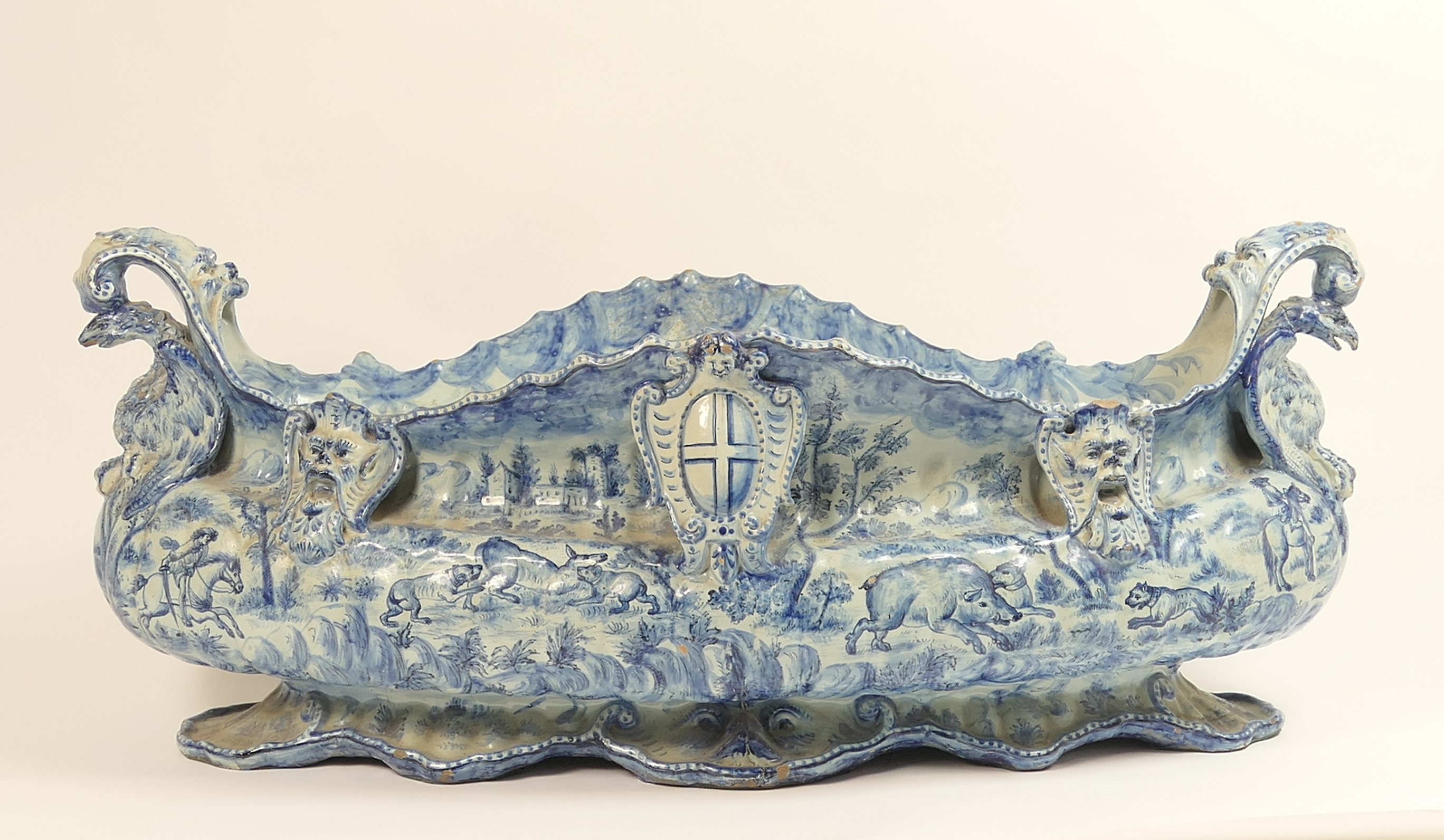 Lot 28 - Impressive and large Savona blue and white maiolica table centre, 19th Century, boat shape with mask