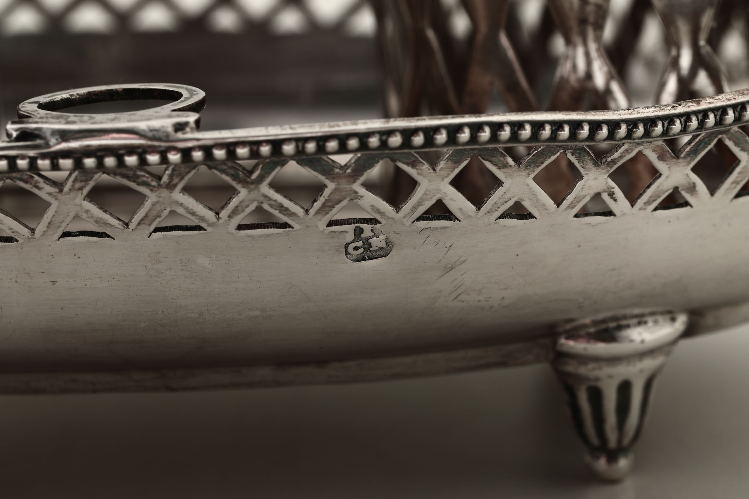 Lot 51 - A silver cruet stand, Germany, 1700s - Molten, embossed, perforated and chiselled [...]