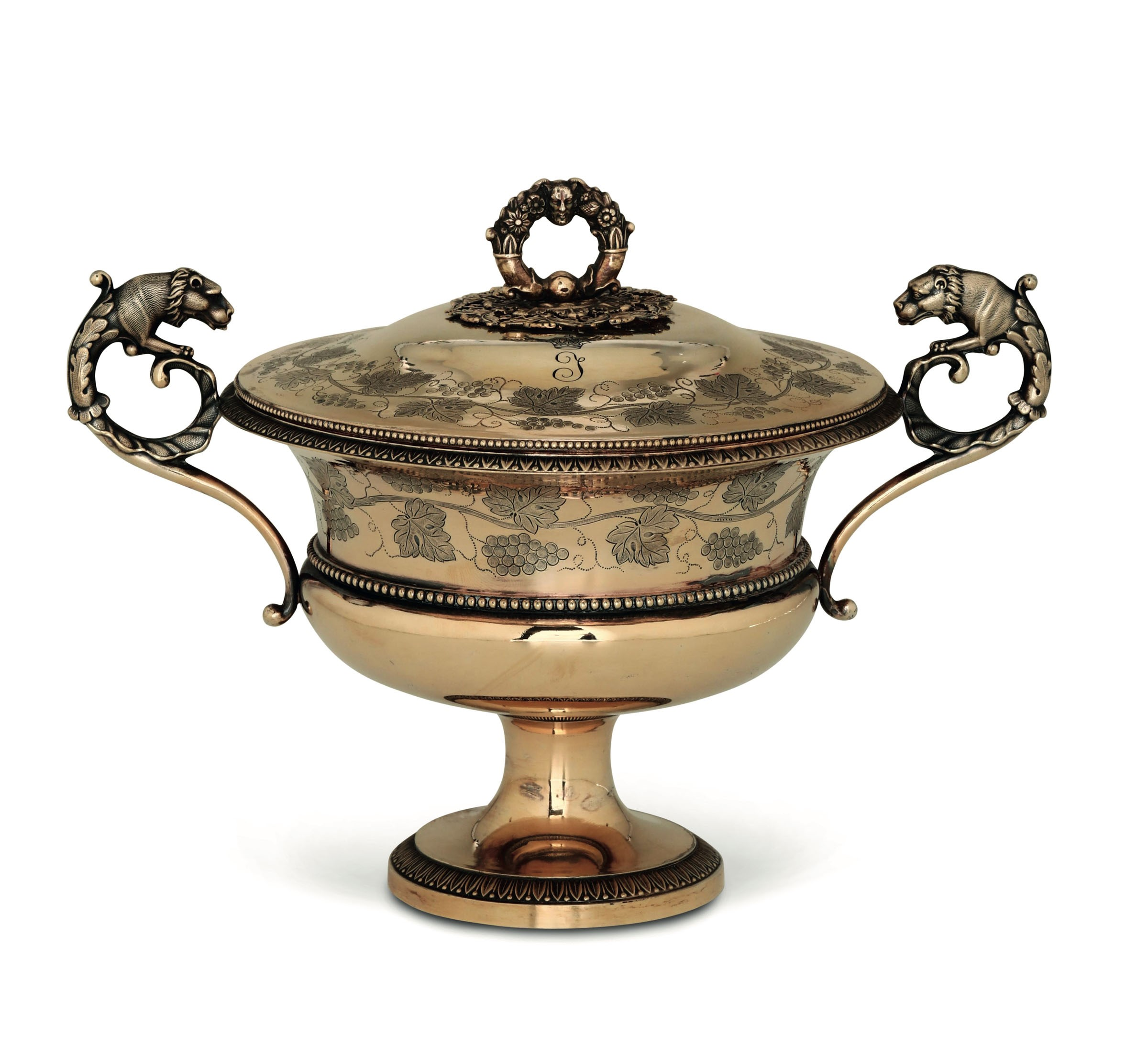 Lot 45 - A silver sugar pot, Paris, 1830s - Molten, embossed and chiselled vermeille silver. [...]
