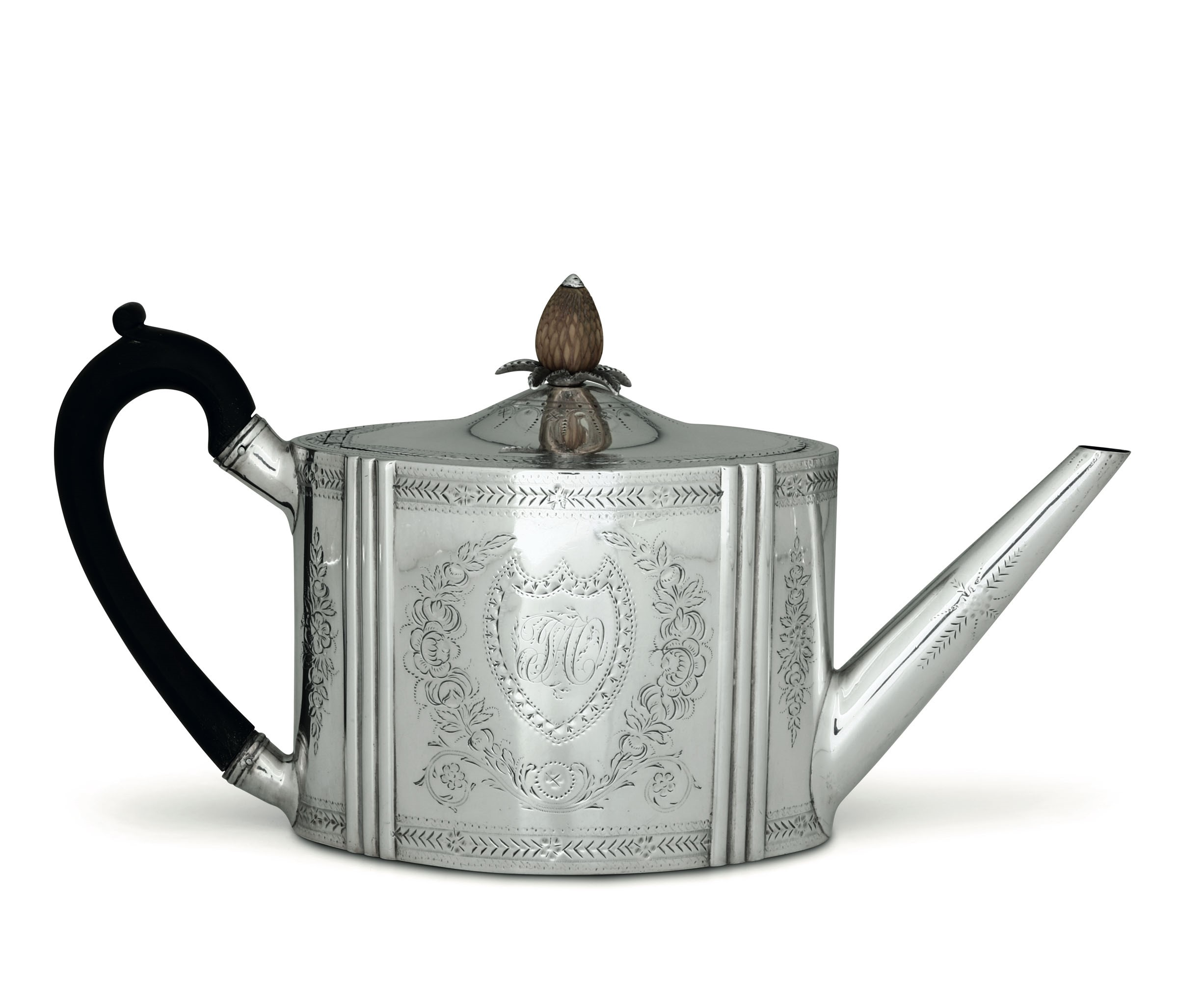 Lot 29 - A silver teapot, London, 1838 - Molten, embossed and chiselled silver. Silversmith [...]