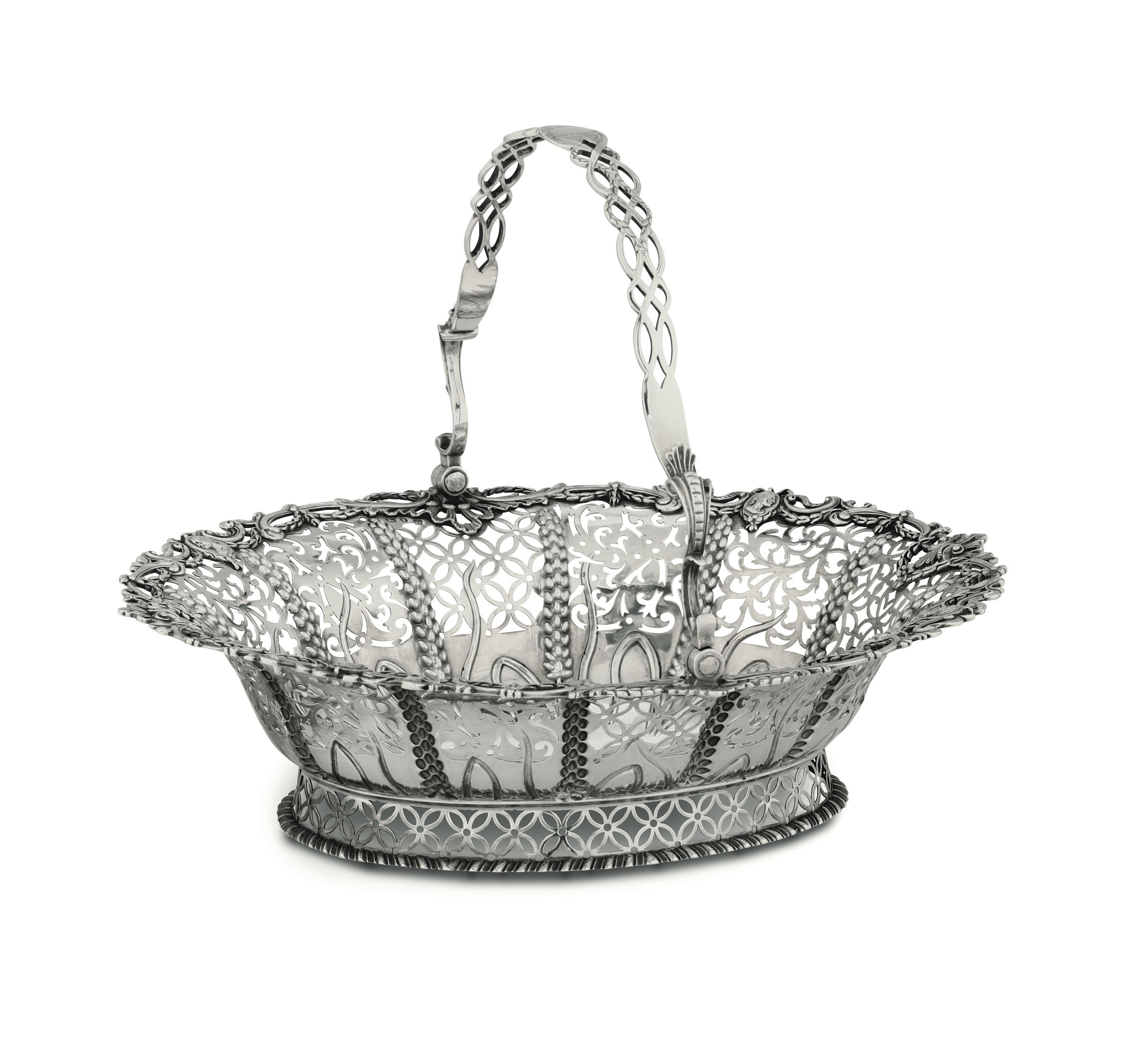 Lot 20 - A silver basket, London, 1771 - Molten, embossed and chiselled silver. 36x31x10cm, [...]