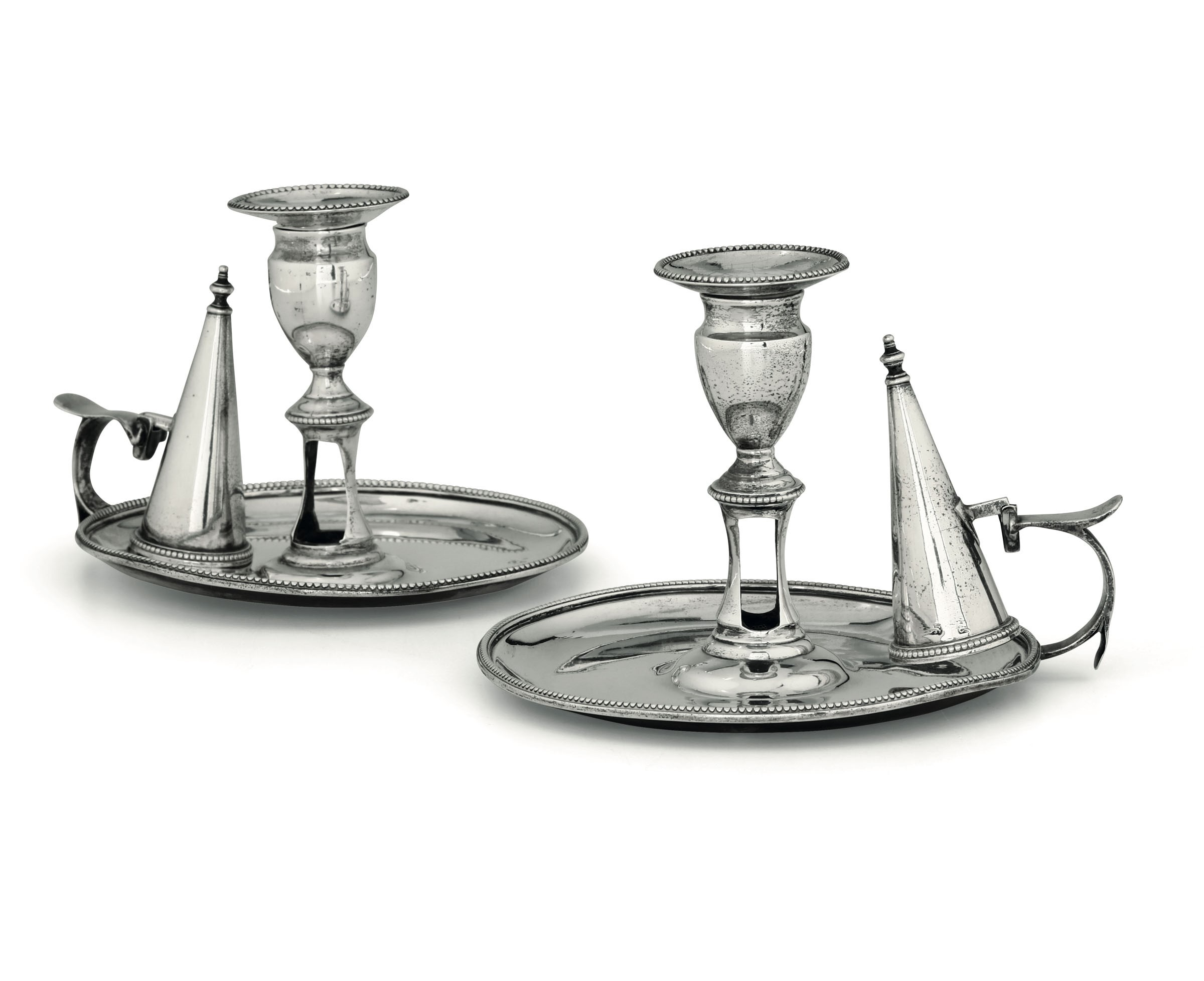 Lot 37 - Two silver candle holders, London, 1803 and 1780 - Molten, embossed and chiselled [...]