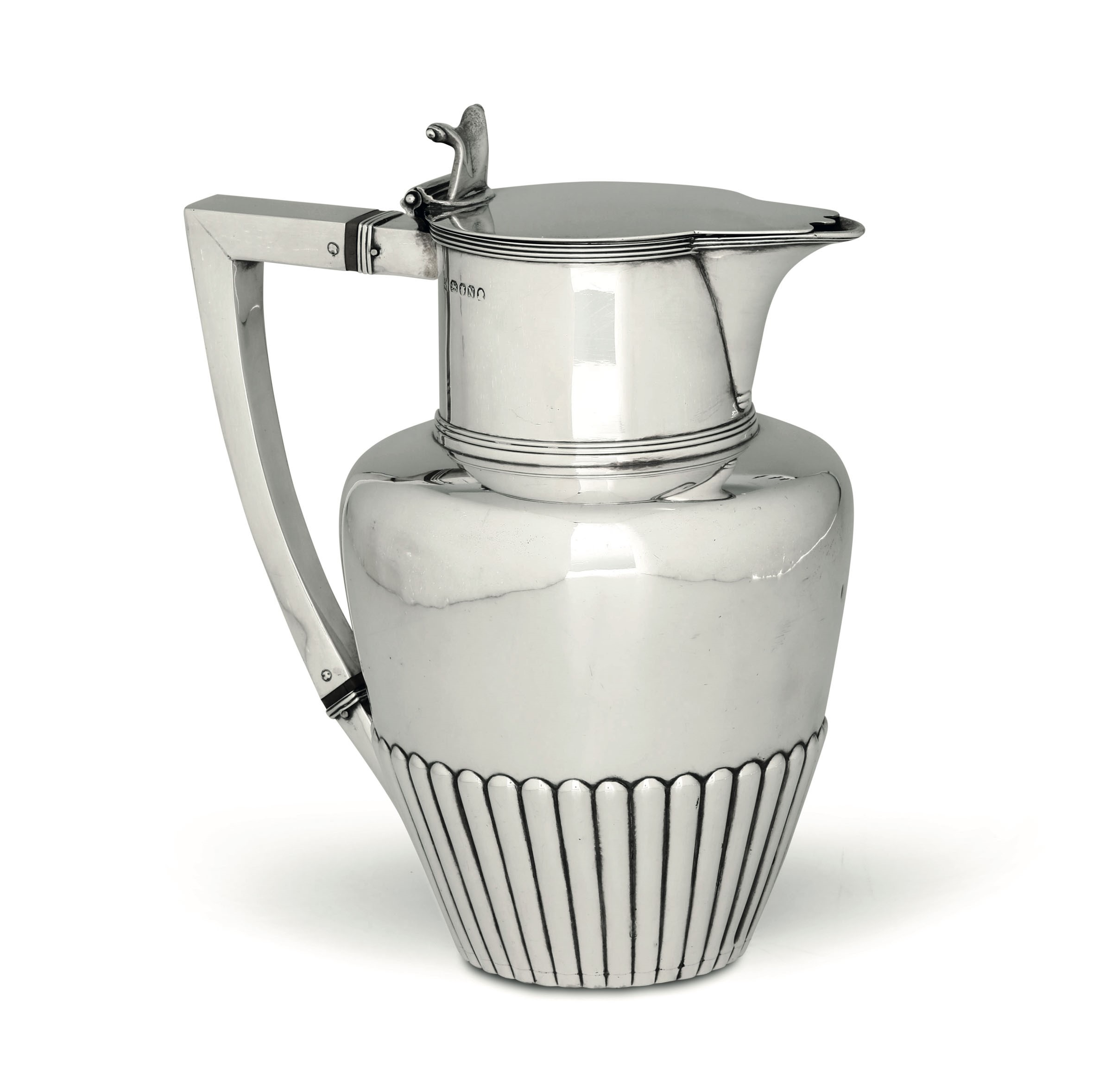 Lot 15 - A silver pitcher, London, 1808 - Molten, embossed and chiselled silver. Silversmith [...]