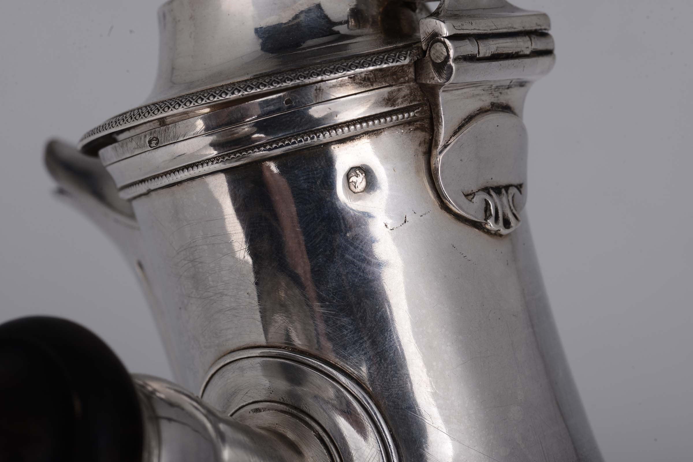 Lot 42 - A silver coffee pot, Paris, 1794 - Molten, embossed and chiselled silver. Silversmith [...]
