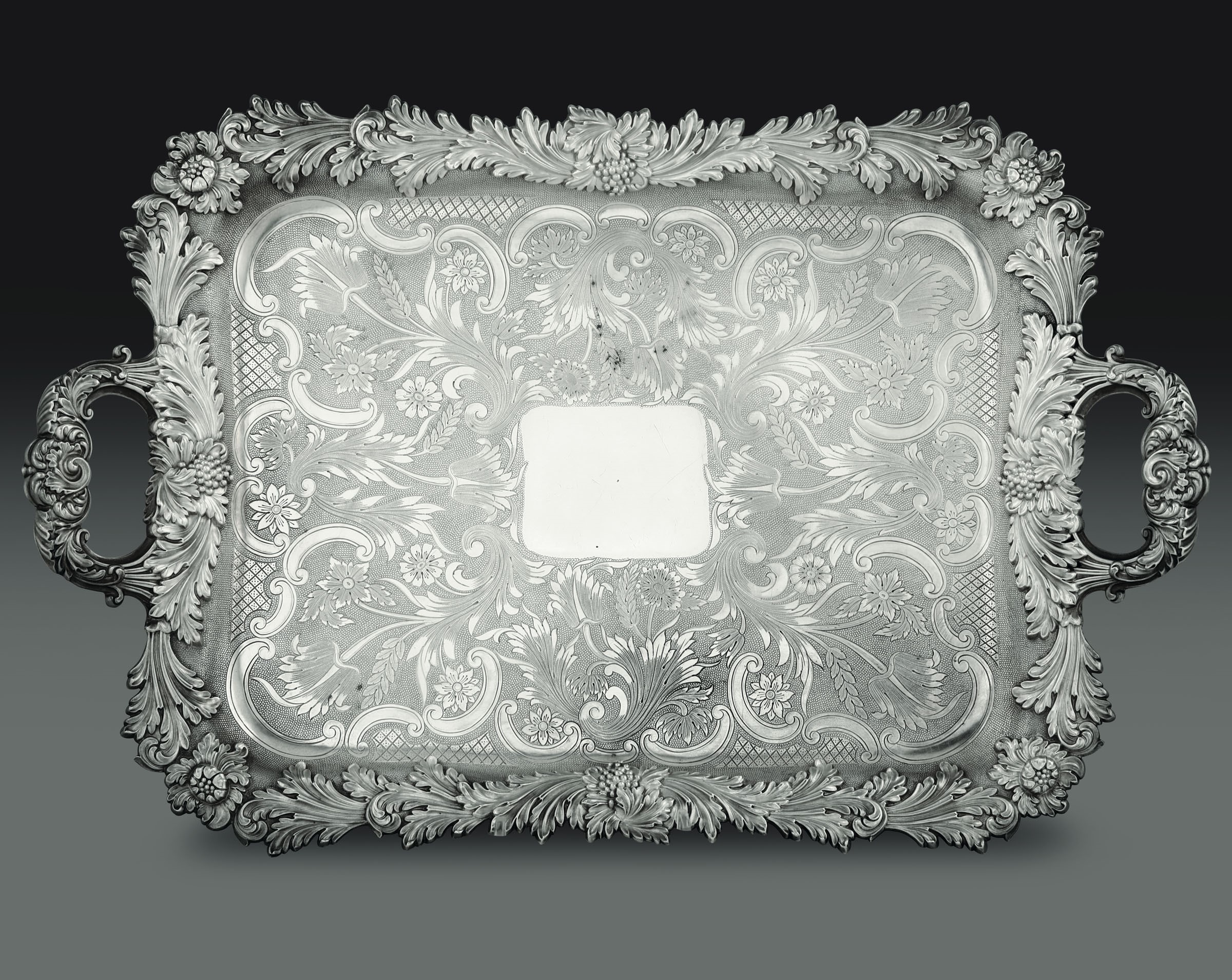 Lot 62 - A silver tray, Maison Odiot, Paris, late 1800s - - Molten and chiselled silver. [...]