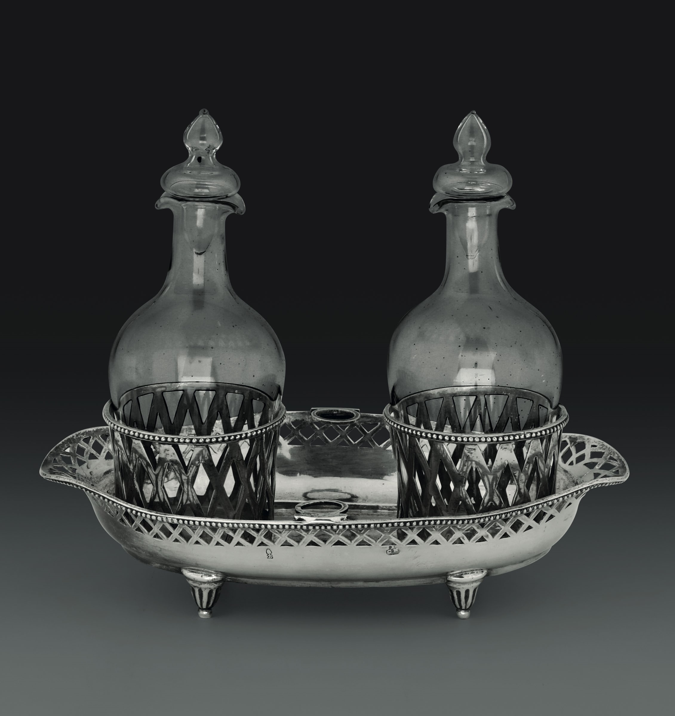 Lot 51 - A silver cruet stand, Germany, 1700s - - Molten, embossed, perforated and chiselled [...]