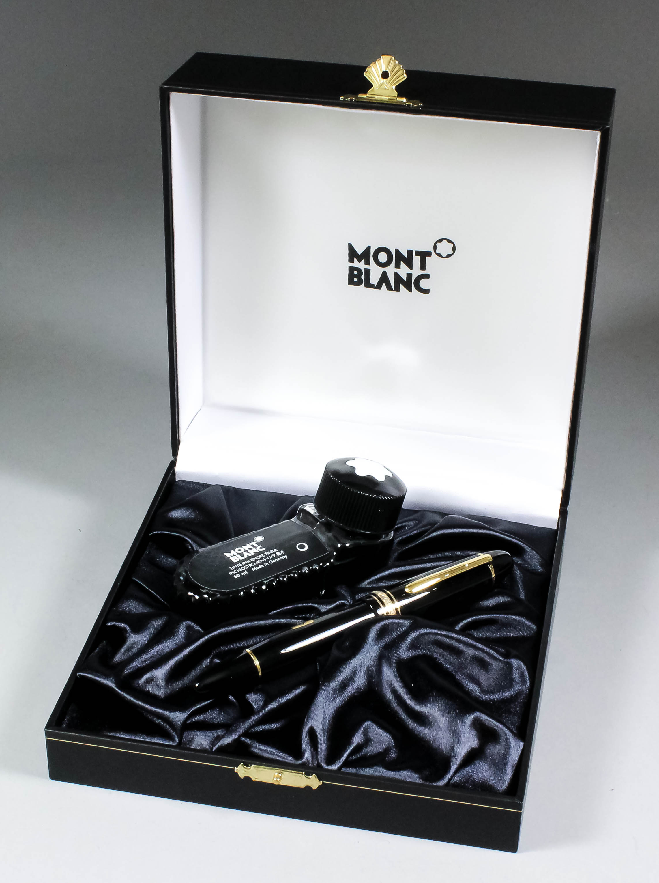 """Lot 753 - A Montblanc """"Meisterstück"""" fountain pen, Model No. 149, with ink bottle, in original box and with"""