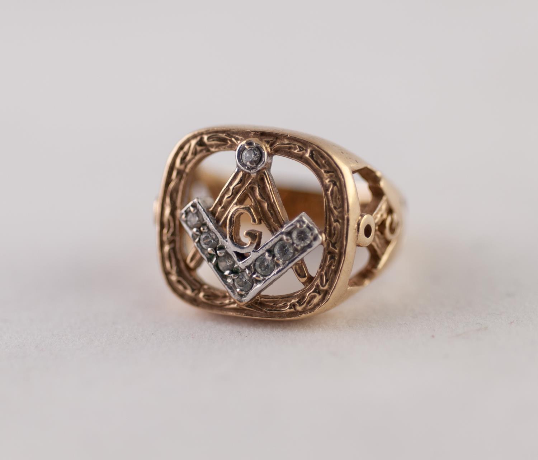 Lot 221 - 9ct GOLD WHITE SAPPHIRE MASONIC RING with pierced and paste set Masonic motif, ring size O, 9g