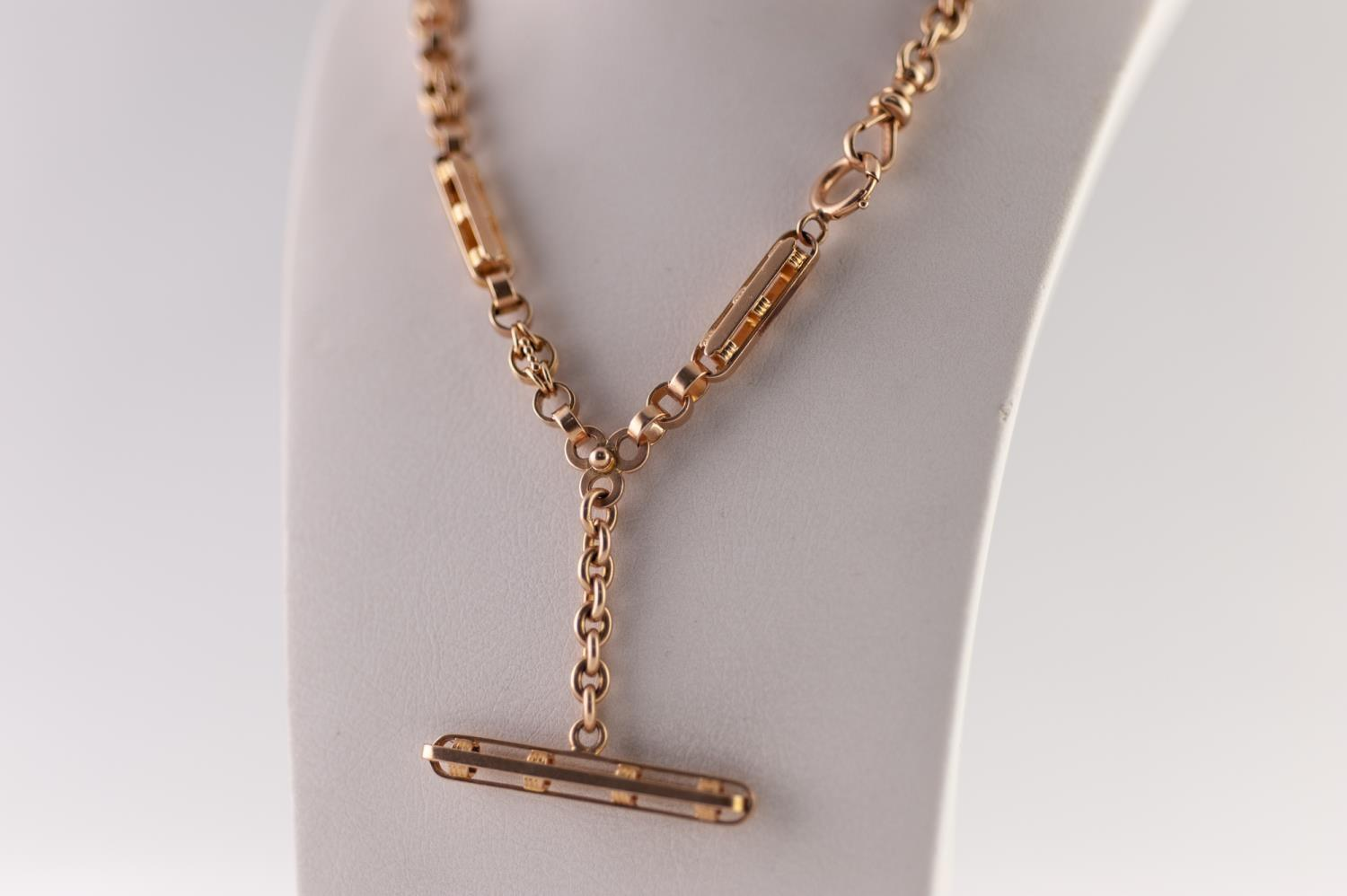 Lot 205 - GOLD FANCY LINK ALBERT, of long and short ribbed links, with fancy T-bar and clips, stamped '14k',