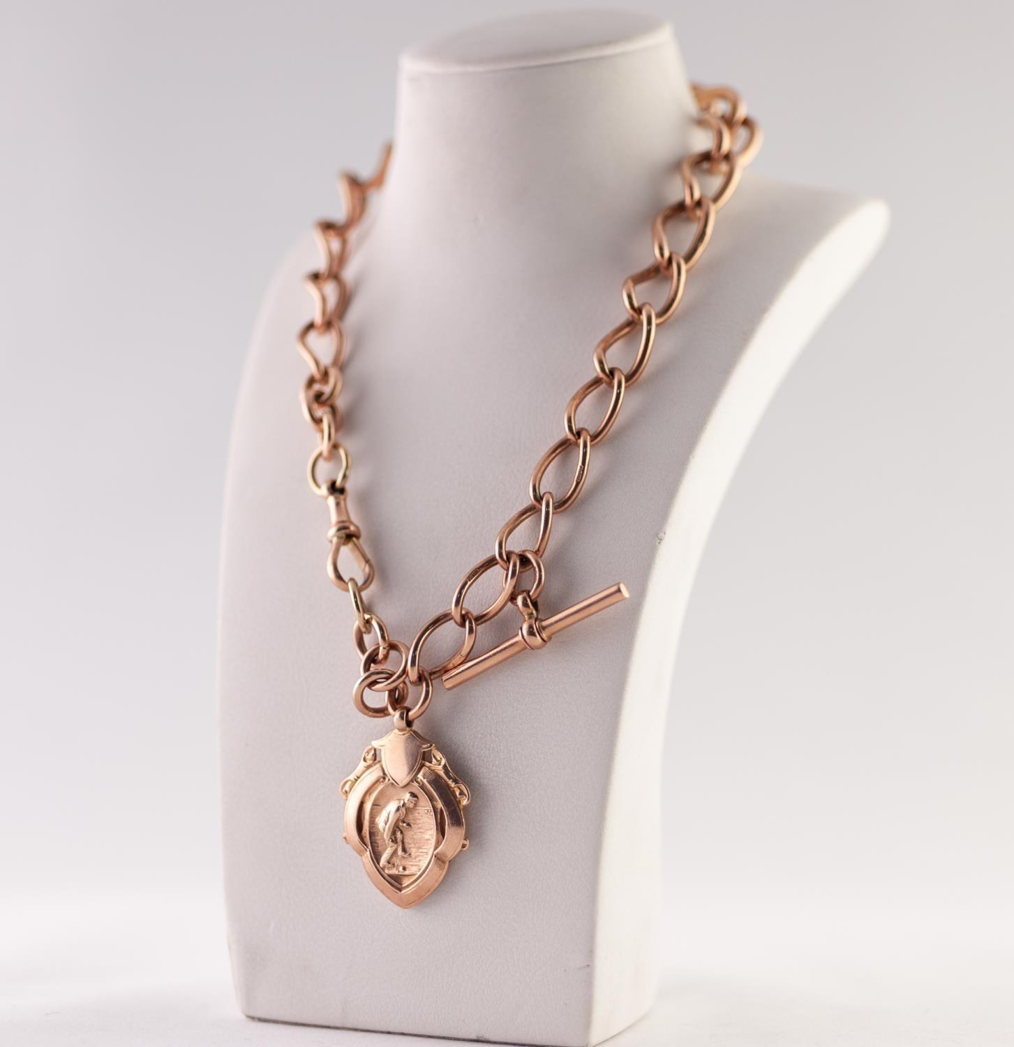 Lot 204 - 9ct GOLD LARGE GRADUATED CURB LINK ALBERT CHAIN, with T-bar, clip and 9ct gold sports medallion,
