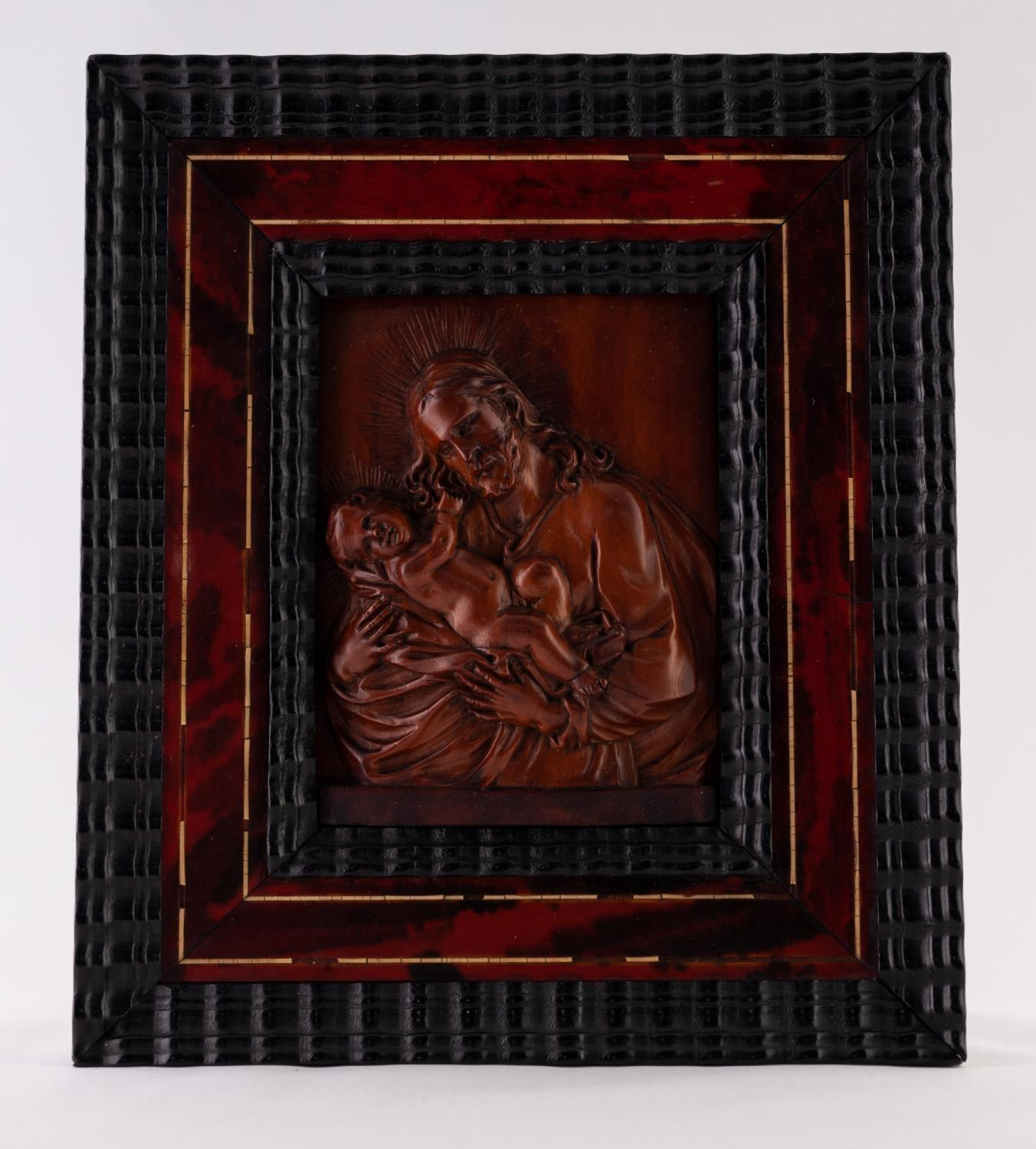Lot 56 - AN 18TH CENTURY FLEMISH CARVED FRUITWOOD RELIEF OF JOSEPH CRADLING THE CHRIST CHILD, contained