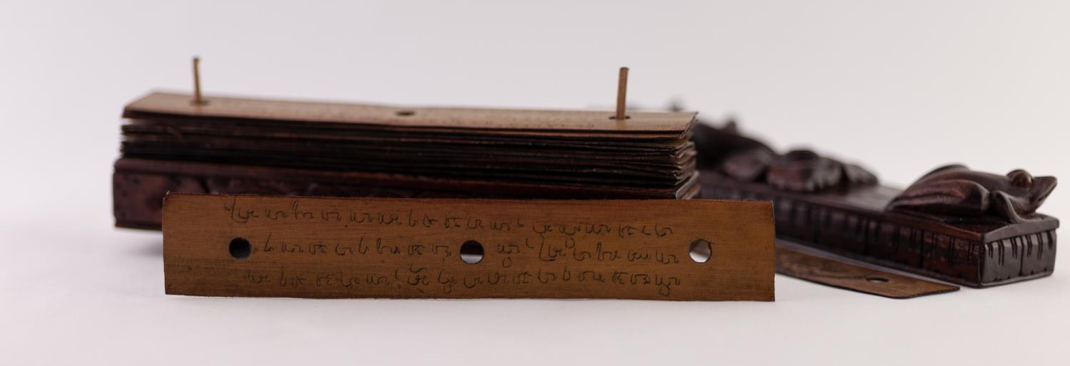 Lot 55 - AN UNUSUAL LATE 19TH CENTURY PERUVIAN BOOK, formed of sixteen thin wooden hand written leaves held
