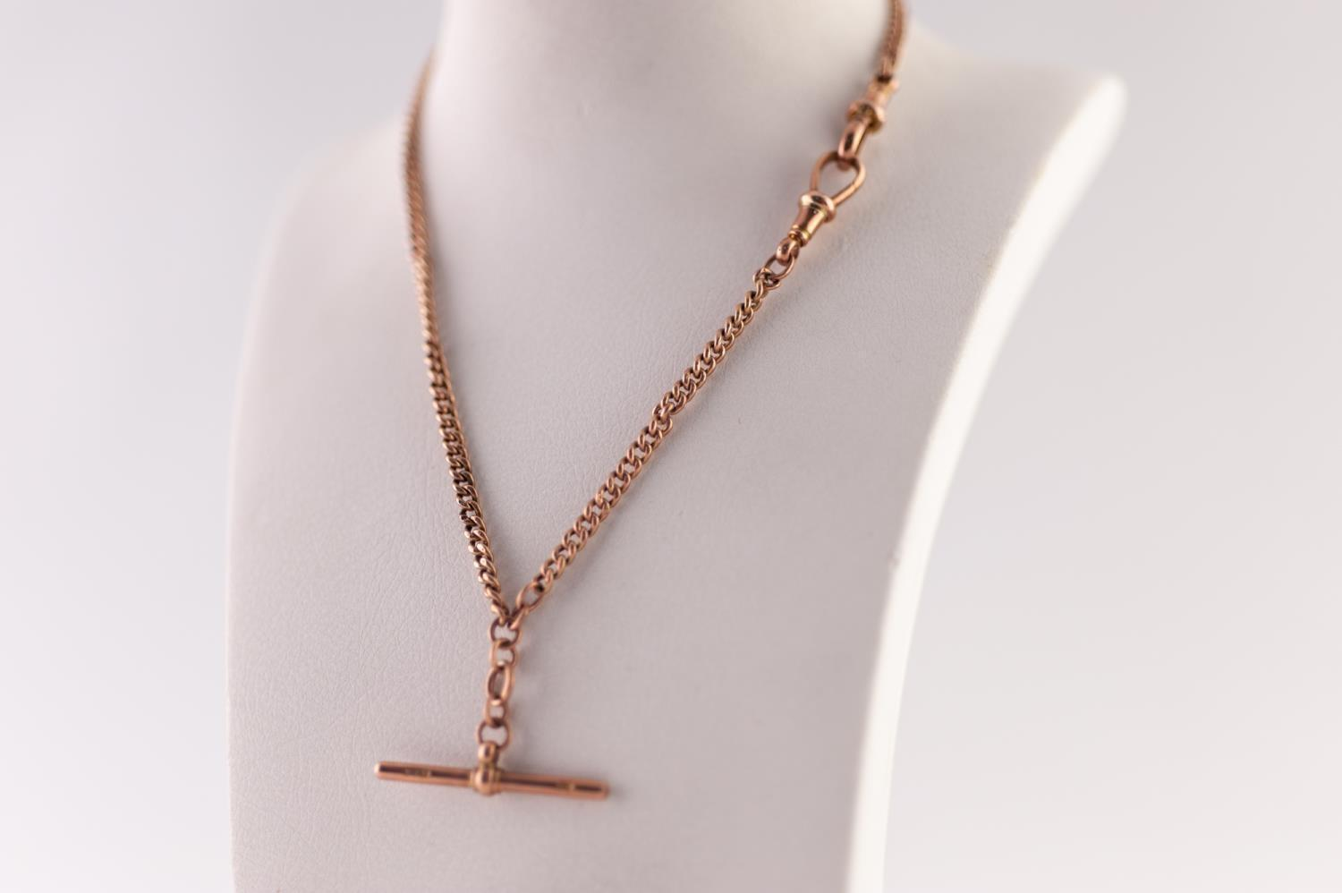 Lot 208 - 9ct ROSE GOLD CURB LINK ALBERT CHAIN, with T-bar and two clips, length 33.5cm, 6.57g
