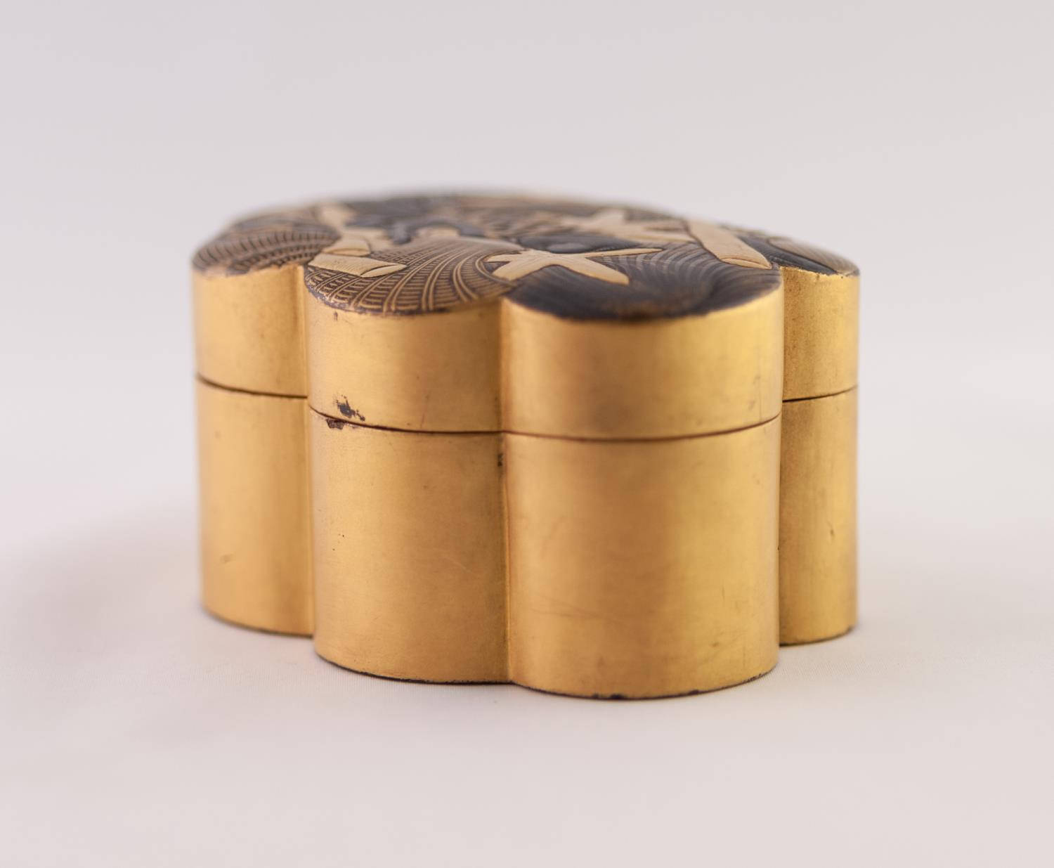Lot 37 - JAPANESE MEIJI PERIOD SMALL POLYFOIL SHAPED BLACK AND GOLD LACQUERED BOX, the removable cover with