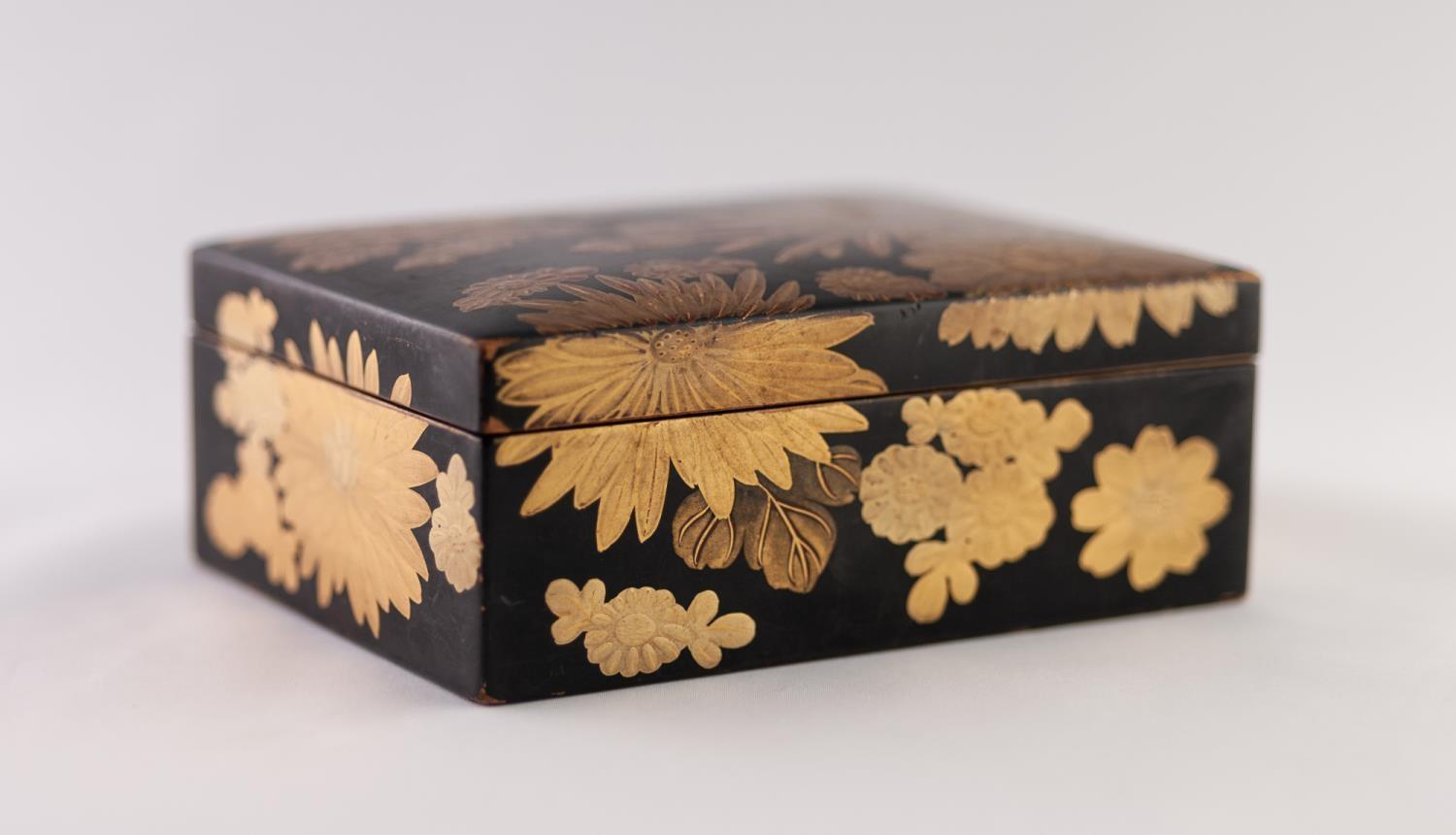"""Lot 39 - A JAPANESE MEIJI PERIOD SMALL LACQUERED BOX, gilded with chrysanthemum, 4 3/4"""" (12cm) long"""
