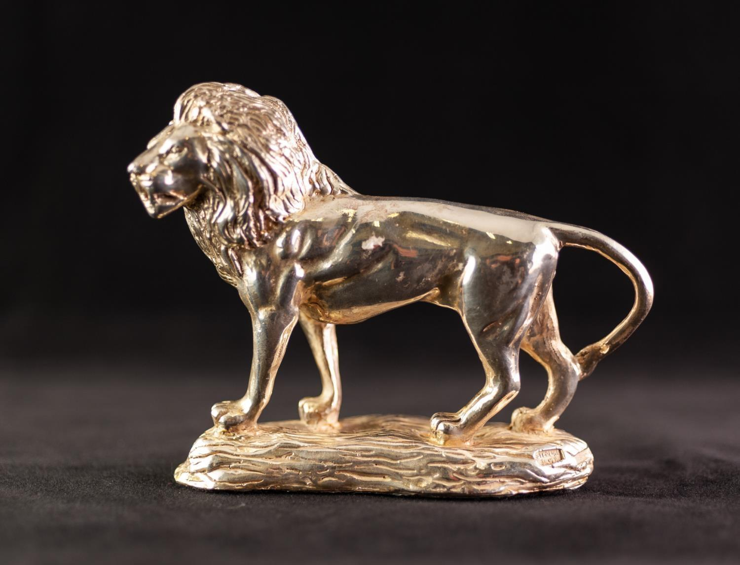 "Lot 449 - MODERN STERLING SILVER CLAD RESIN MODEL OF A STANDING LION on naturalistic base, 5 1/4"" (13.3)"