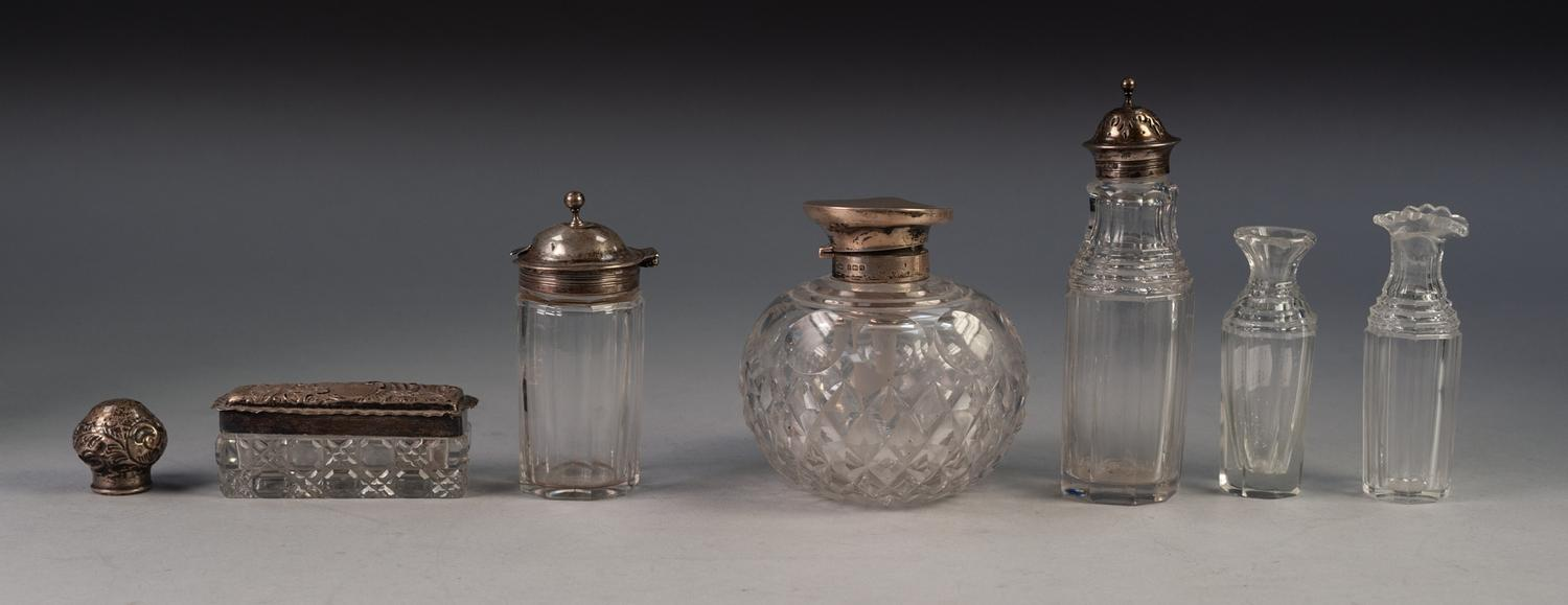 Lot 680 - GEORGE V SILVER MOUNTED CUT GLASS PERFUME BOTTLE, of orbicular form with flat hinged cover,