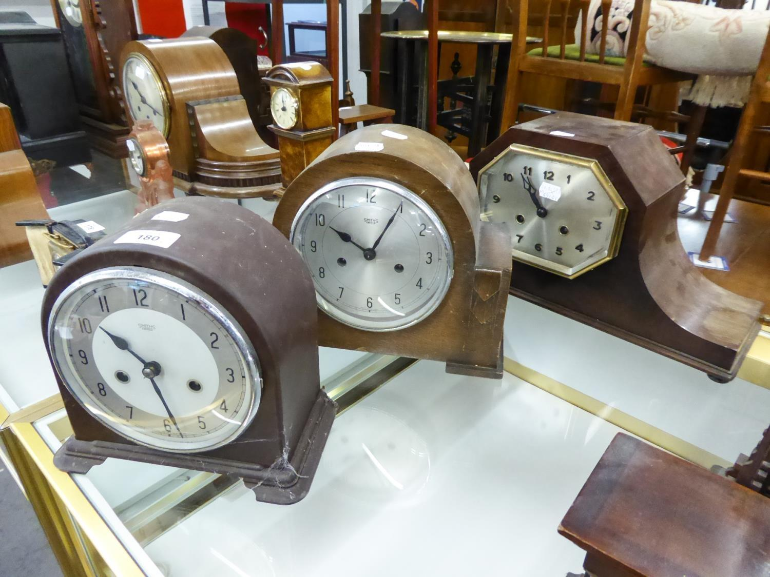 Lot 180 - 1930s OAK CASED NAPOLEON'S HAT SHAPE MANTEL CLOCK with octagonal silvered arabic dial, together with