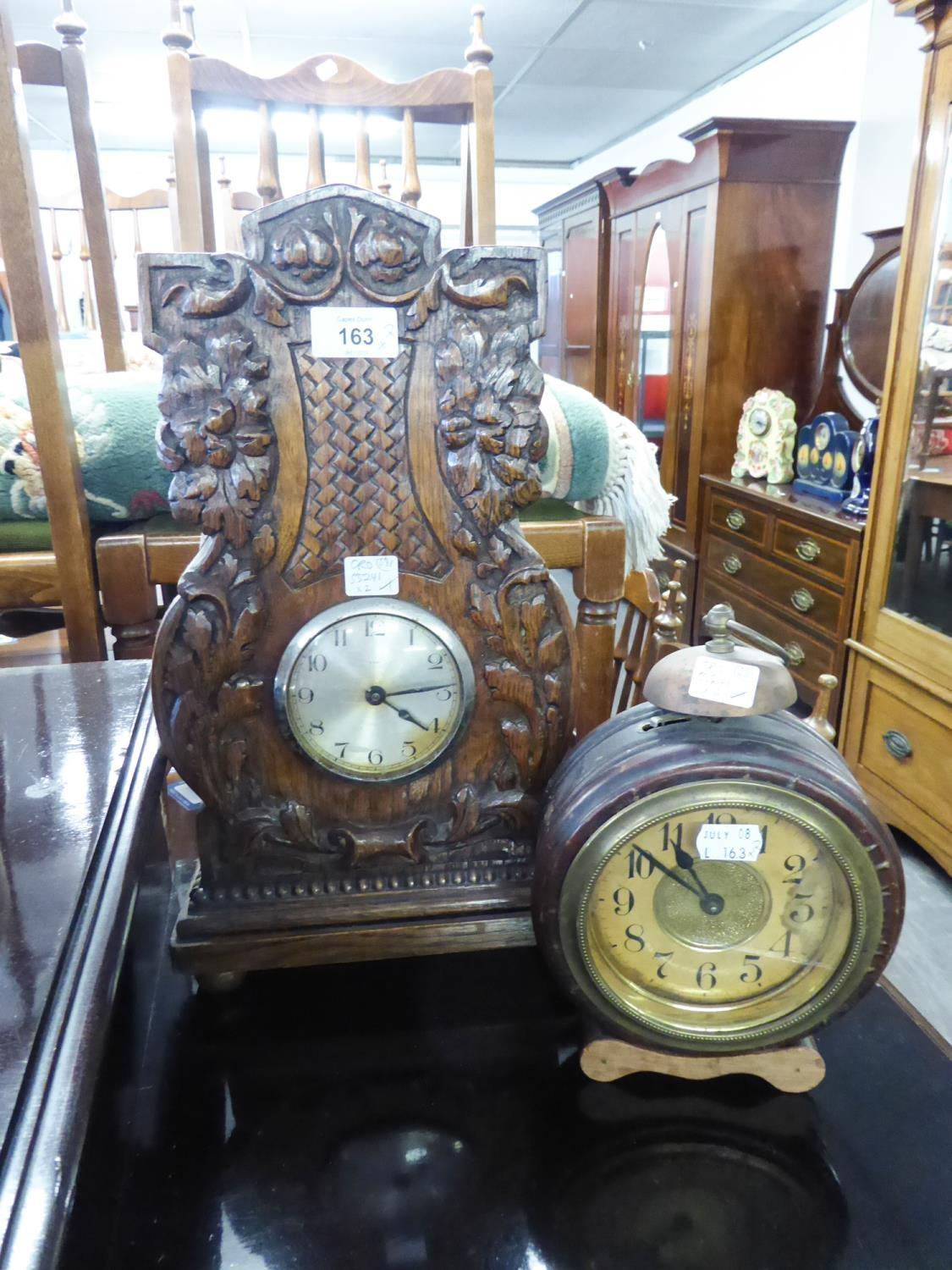 Lot 163 - CIRCA 1920's TALL MANTEL CLOCK WITH PLATED DRUM SHAPED 8 DAY MOVEMENT IN OAK CASE WITH FOLIATE AND