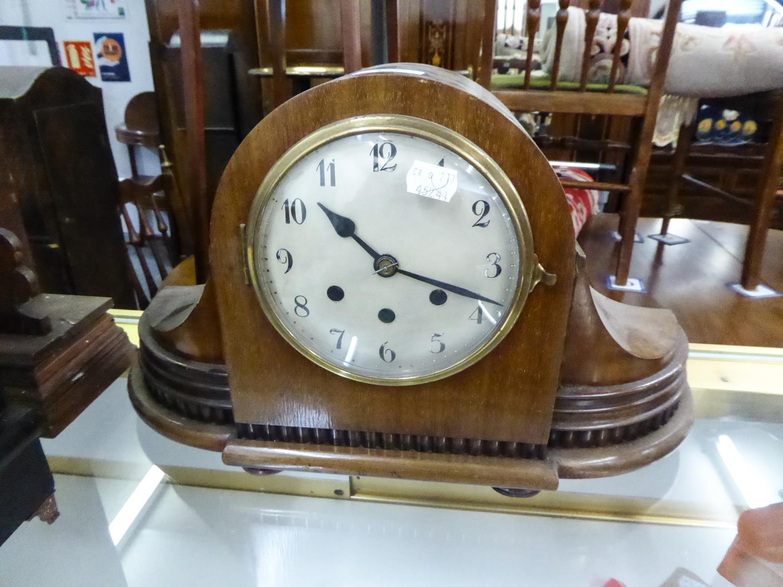 "Lot 177 - 1930s WALNUT CASED MANTEL CLOCK with swept corners, 18 1/2"" (47cm) long"