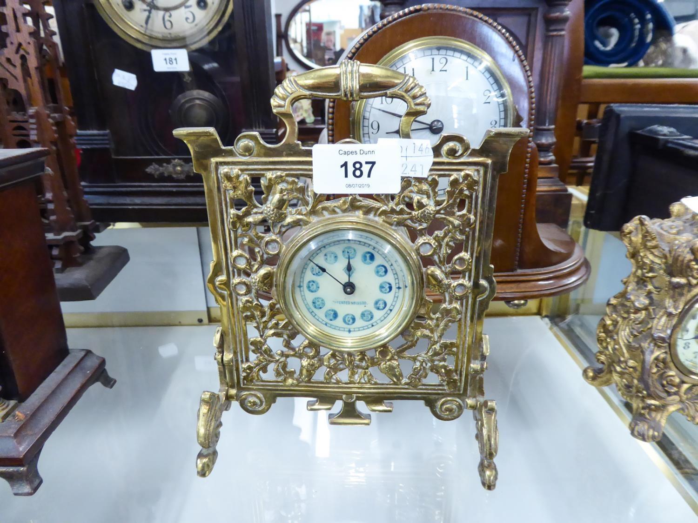 Lot 187 - CIRCA 1900 CAST BRASS 'FIRE-SCREEN' FORM BEDROOM MANTEL-SHELF CLOCK, the arabic dial stamped