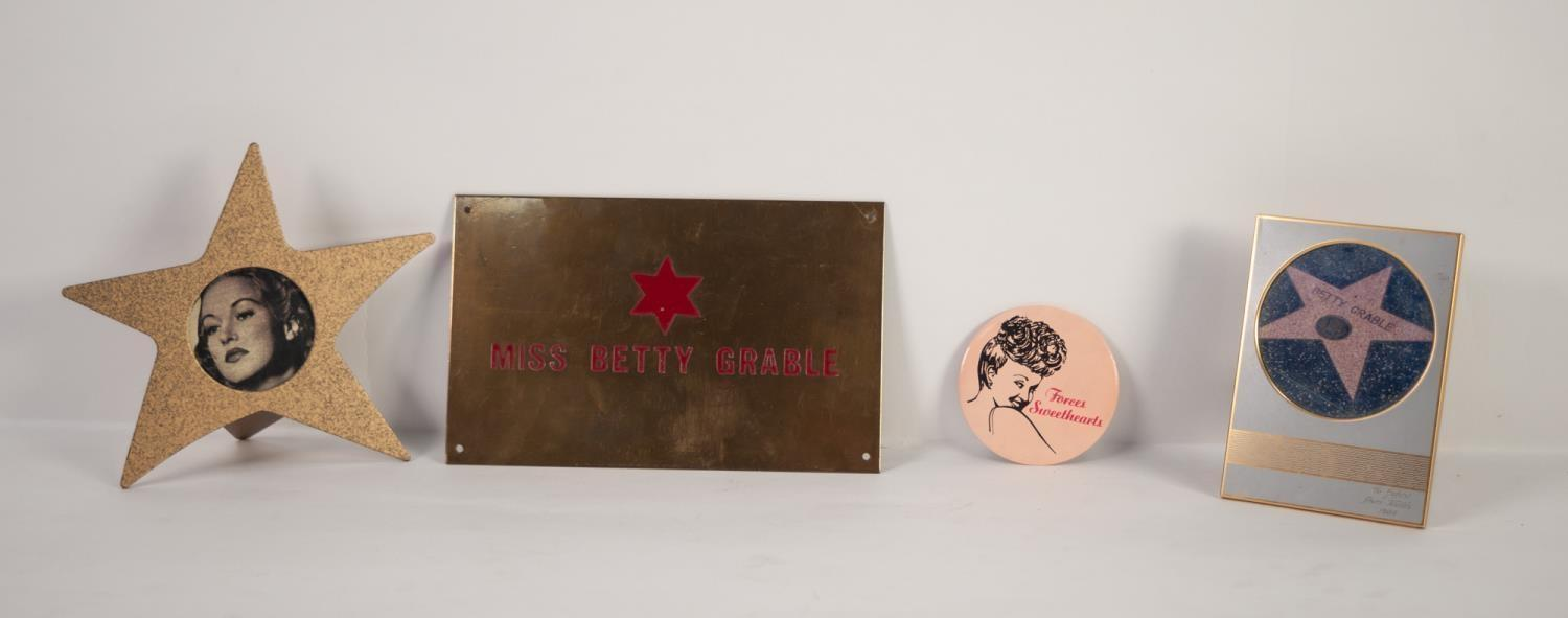 """Lot 236 - 'BETTY GRABLE' BRASS DRESSING ROOM NAME PLATE, 5"""" x 8"""" (12.7 x 20.3cm) and three related items (4)"""