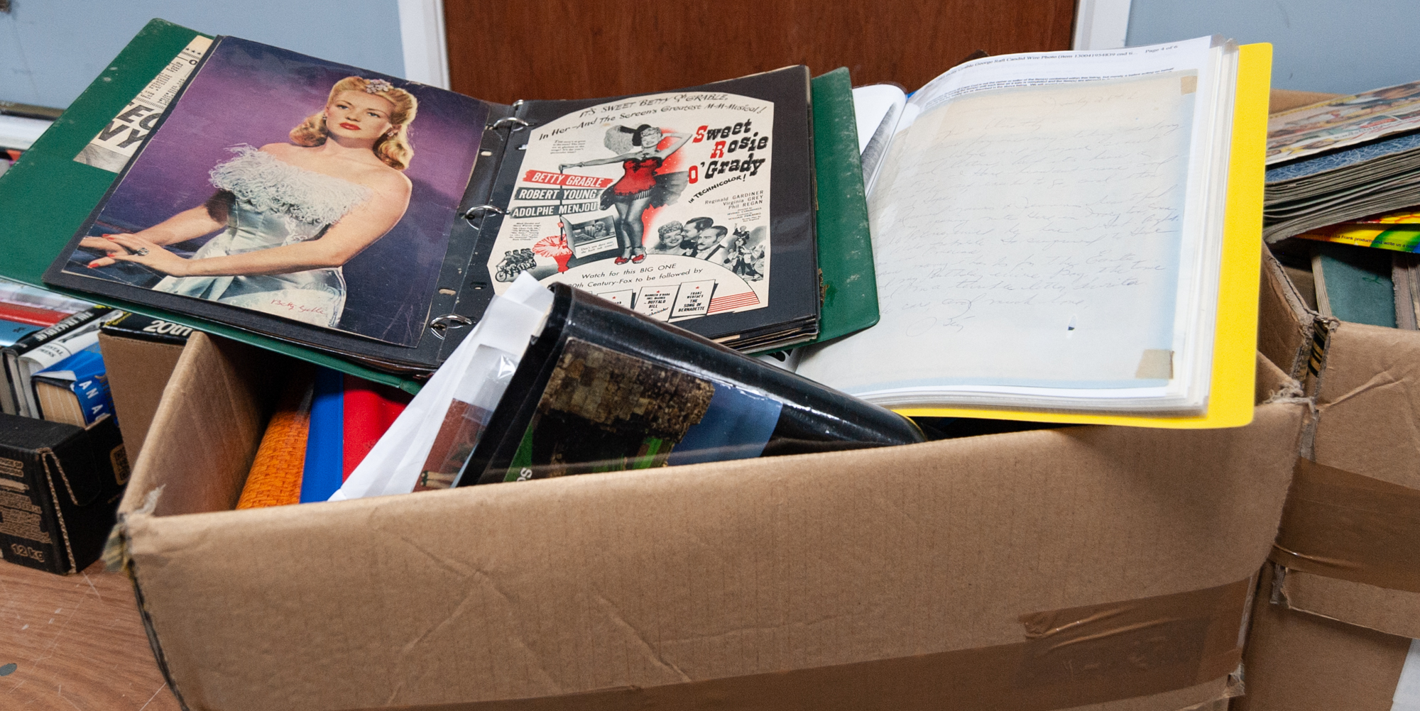 Lot 291 - LARGE COLLECTION OF BETTY GRABLE SCRAPS AND PRESS CUTTINGS, all in albums, contents of one large box